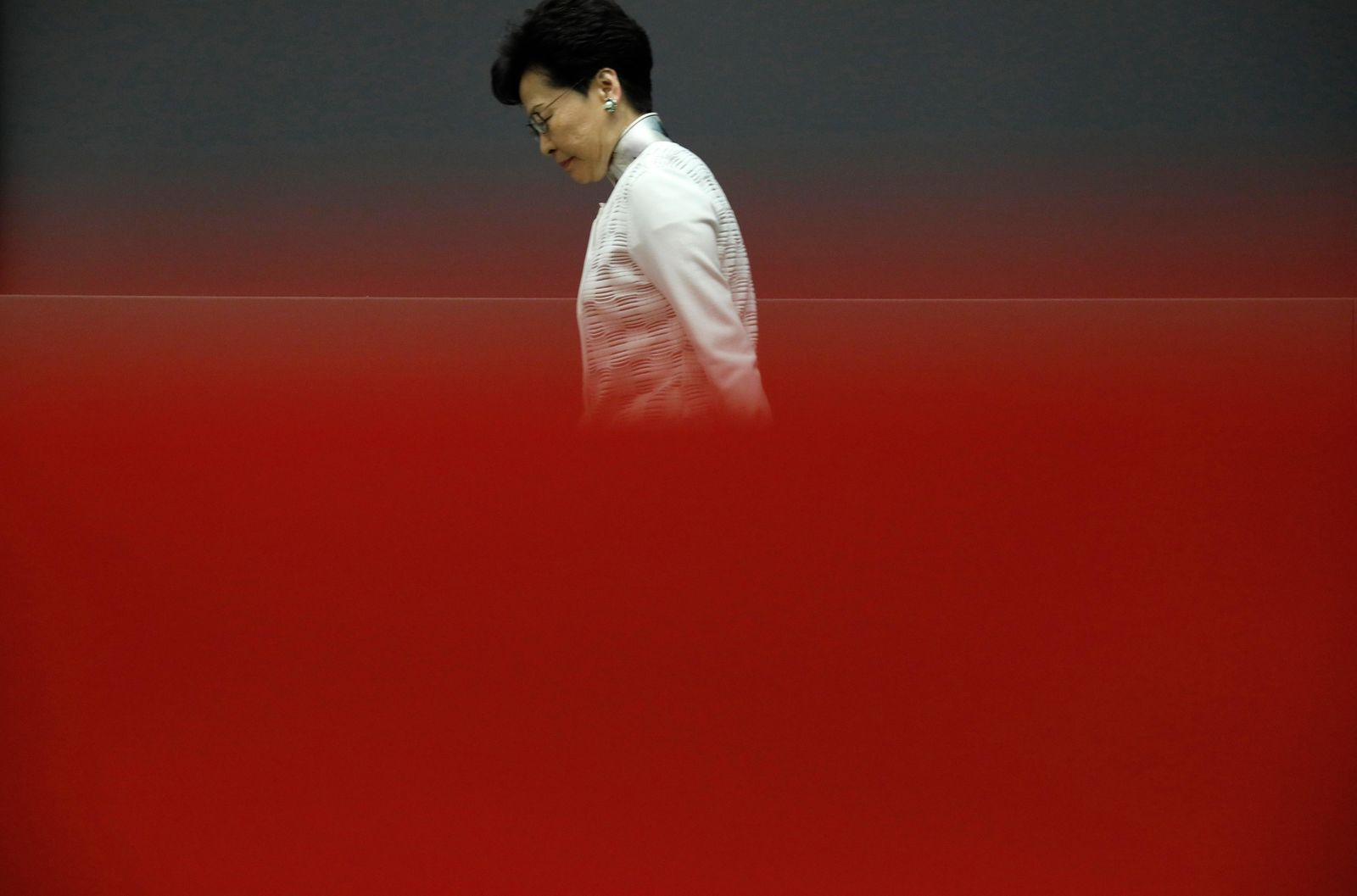 Hong Kong Chief Executive Carrie Lam walks behind a red barrier tape toward a press conference in Hong Kong Saturday, June 15, 2019.{ } (AP Photo/Vincent Yu)