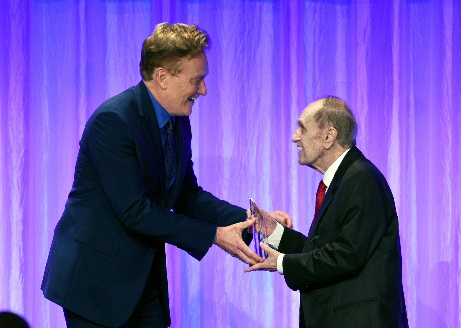 "Honoree Bob Newhart, right, accepts his award from presenter Conan O'Brien during ""The Paley Honors: A Special Tribute to Television's Comedy Legends"" at the Beverly Wilshire Hotel, Thursday, Nov. 21, 2019, in Beverly Hills, Calif. (Photo by Chris Pizzello/Invision/AP)"