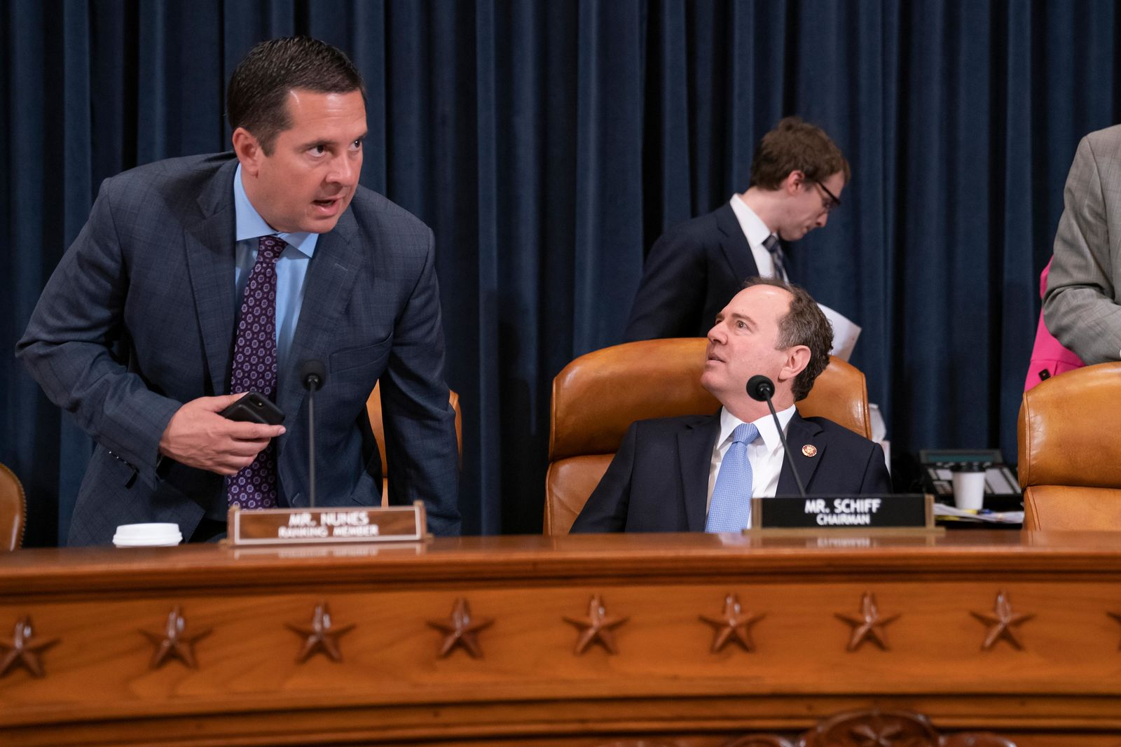 Rep. Devin Nunes, R-Calif, the ranking member on the House Intelligence Committee, left, takes his seat beside Chairman Adam Schiff, D-Calif., as they open a hearing on politically motivated fake videos and manipulated media, on Capitol Hill in Washington, Thursday, June 13, 2019.(AP Photo/J. Scott Applewhite)