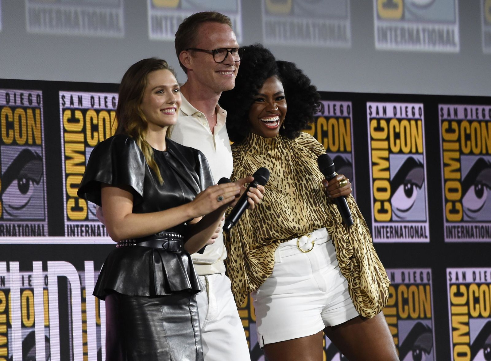 "Elizabeth Olsen, from left, Paul Bettany and Teyonah Parris participate in the ""WandaVision"" portion of the Marvel Studios panel on day three of Comic-Con International on Saturday, July 20, 2019, in San Diego. (Photo by Chris Pizzello/Invision/AP)"
