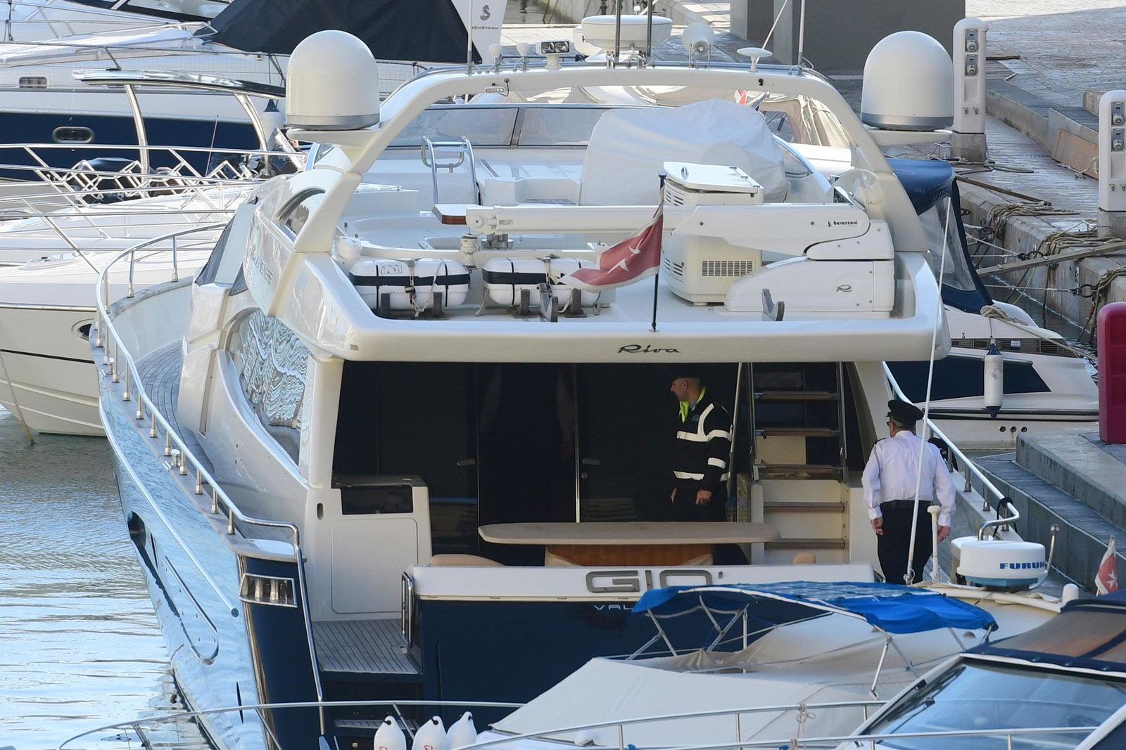 "Police aboard the yacht ""Gio"" after it was intercepted on a course for Sicily by the Maltese military early Wednesday, Nov. 20, 2019, and forced back to Portomaso, Malta.{ } (AP Photo/Jonathan Borg)"