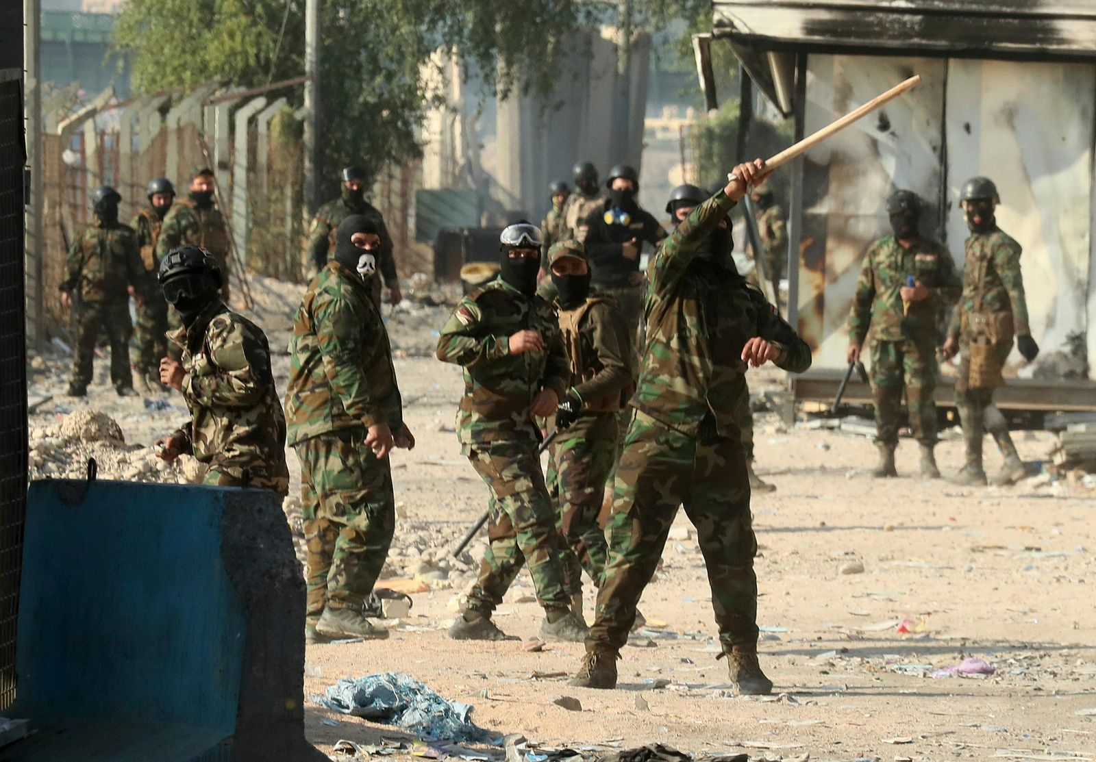 Security forces try to disperse anti-government protesters during clashes in Baghdad, Iraq, Saturday, Nov. 30, 2019. (AP Photo/Hadi Mizban)