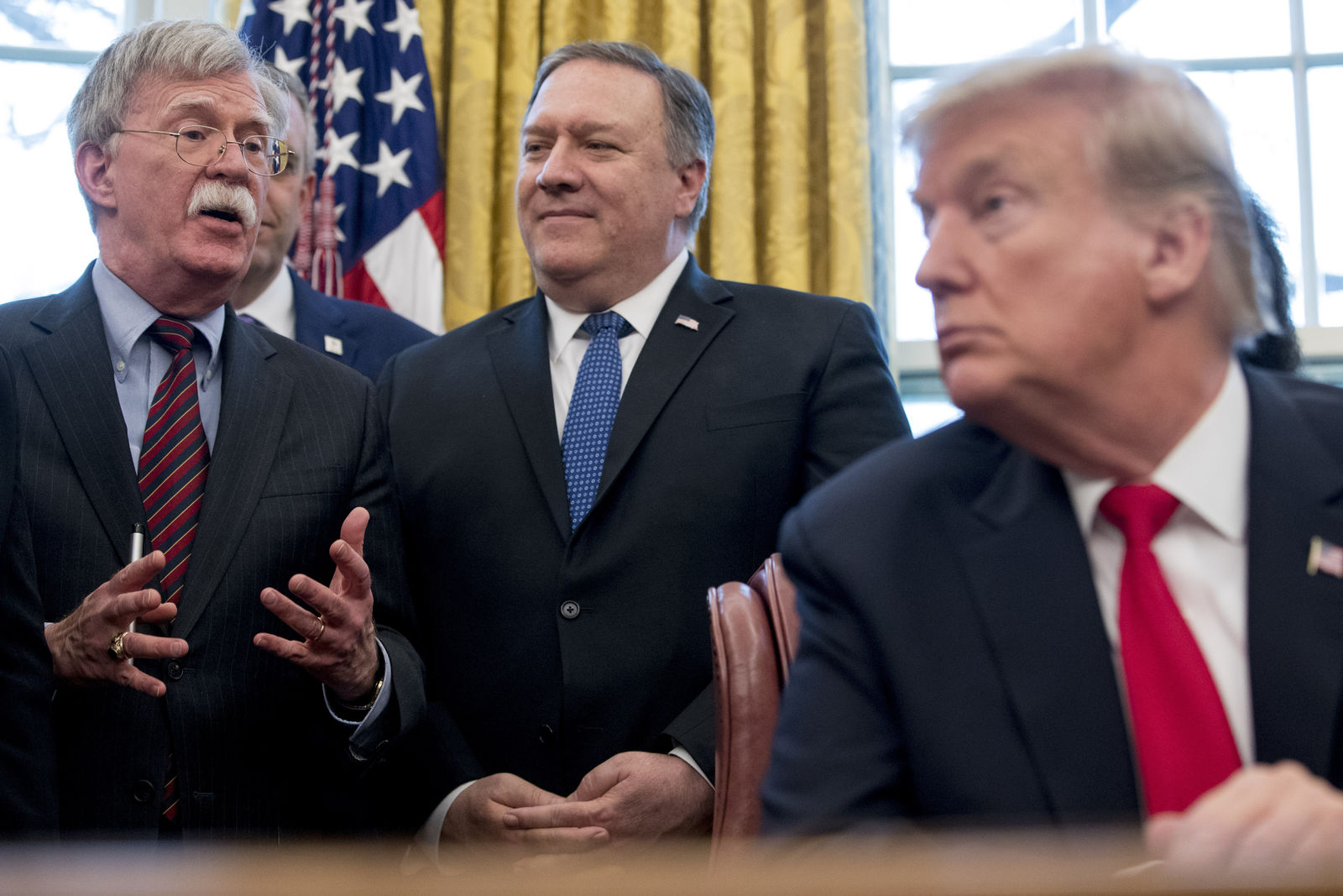 "FILE - In this Feb. 7, 2019 file photo, from left, National Security Adviser John Bolton, accompanied by Secretary of State Mike Pompeo, and President Donald Trump, speaks before Trump signs a National Security Presidential Memorandum to launch the ""Women's Global Development and Prosperity"" Initiative in the Oval Office of the White House in Washington. (AP Photo/Andrew Harnik)"