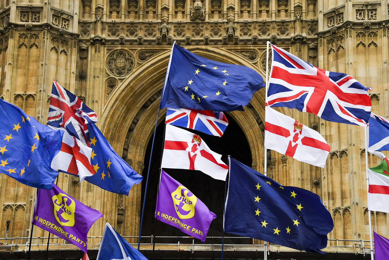 Various flags flutter in the wind outside the houses of Parliament in London, Monday, Oct. 21, 2019.  There are just 10 days until the U.K. is due to leave the European bloc on Oct. 31.(AP Photo/Alberto Pezzali)