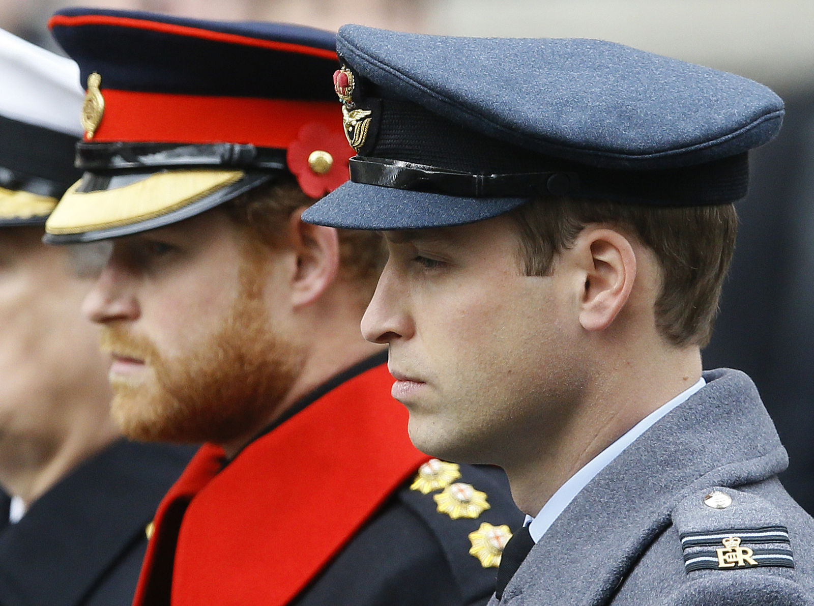 FILE - In this file photo dated Sunday, Nov. 8, 2015, Britain's Prince William, right, Prince Harry, left, attend the Remembrance Sunday ceremony at the Cenotaph in London. Britain's Queen Elizabeth II is set to hold face-to-face talks Monday, Jan. 13, 2020 with Prince Harry for the first time since he and his wife, Meghan, unveiled their controversial plan to walk away from royal roles — at a dramatic family summit meant to chart a future course for the couple. The meeting at the monarch's private Sandringham estate in eastern England will also include Harry's father Prince Charles and his brother Prince William.  (AP Photo/Kirsty Wigglesworth, File)
