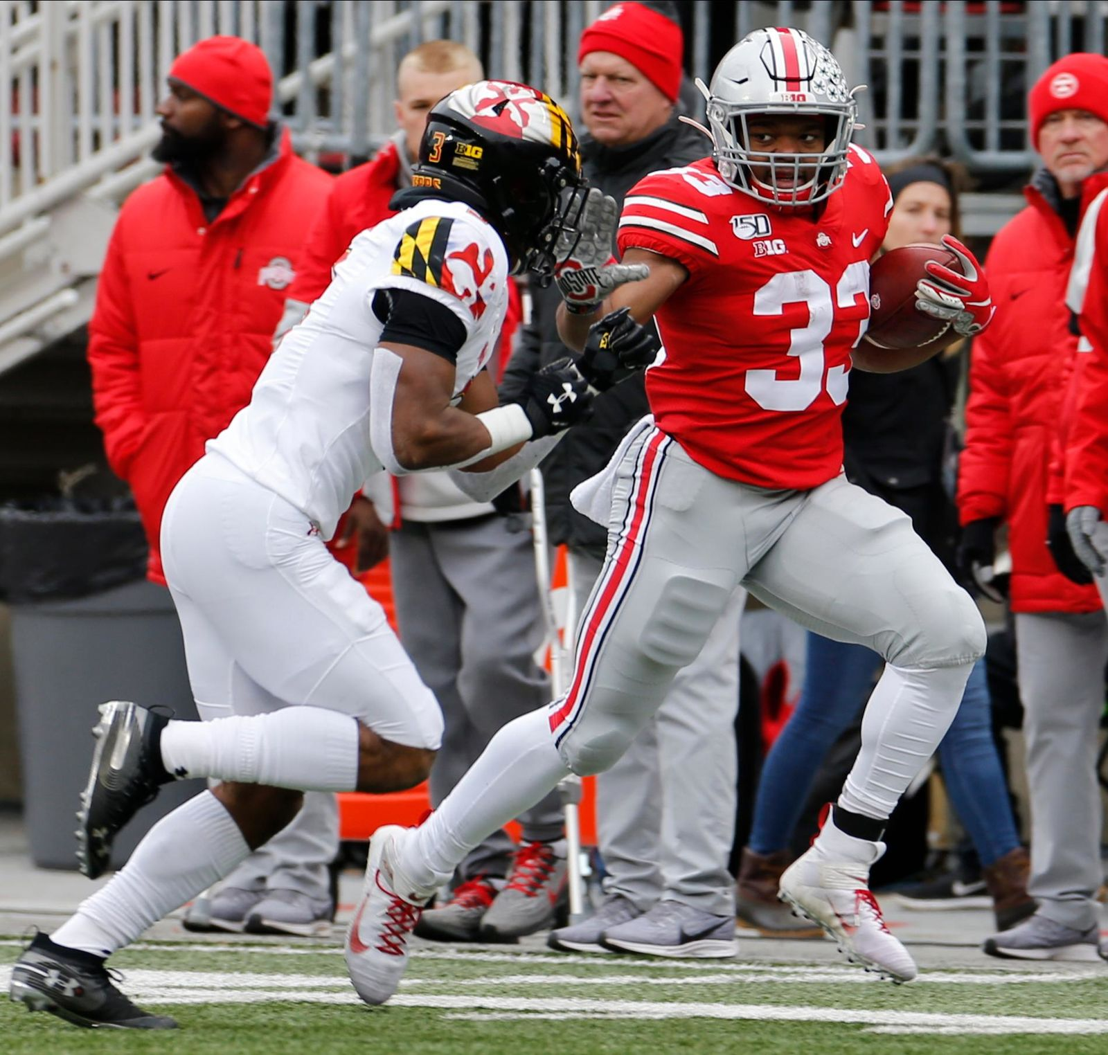 Ohio State running back Master Teague, right, tries to run around Maryland defensive back Nick Cross during the first half of an NCAA college football game, Saturday, Nov. 9, 2019, in Columbus, Ohio. (AP Photo/Jay LaPrete)