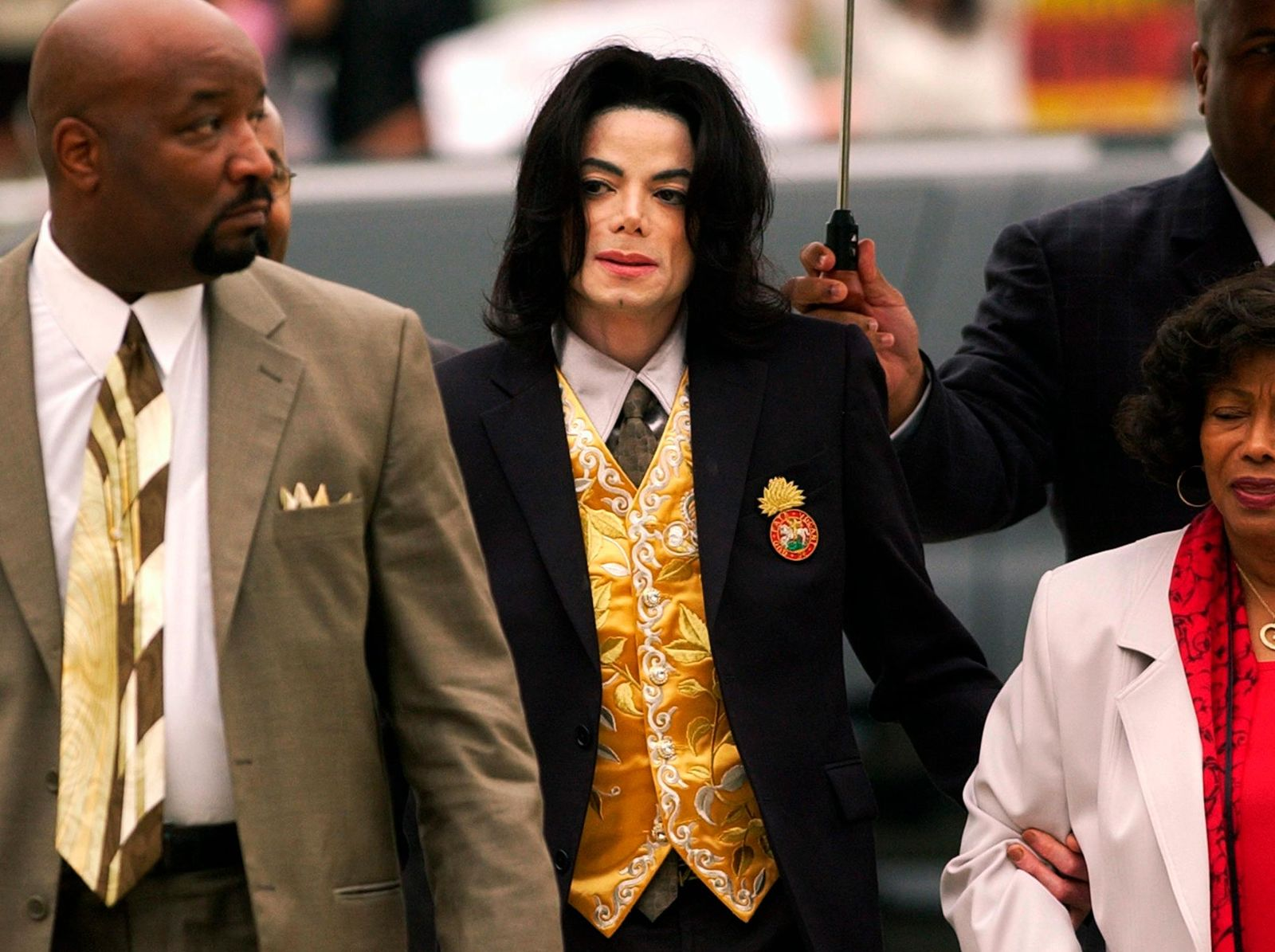 "FILE - In this May 25, 2005 file photo, Michael Jackson arrives at the Santa Barbara County Courthouse for his child molestation trial in Santa Maria, Calif. A documentary film about two boys who accused Michael Jackson of sexual abuse is set to premiere at the Sundance Film Festival later this month. The Sundance Institute announced the addition of ""Leaving Neverland"" and ""The Brink,"" a documentary about Steve Bannon, to its 2019 lineup on Wednesday. The Sundance Film Festival kicks off on Jan 24 and runs through Feb. 4. (Aaron Lambert/Santa Maria Times via AP, Pool)"