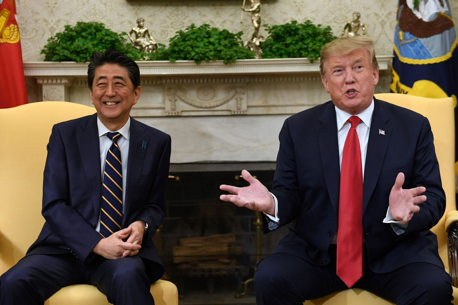 FILE - In this April 26, 2019, file photo, U.S. President Donald Trump, right, speaks while meeting with Japanese Prime Minister Shinzo Abe, left, in the Oval Office of the White House in Washington.{ } (AP Photo/Susan Walsh, File)