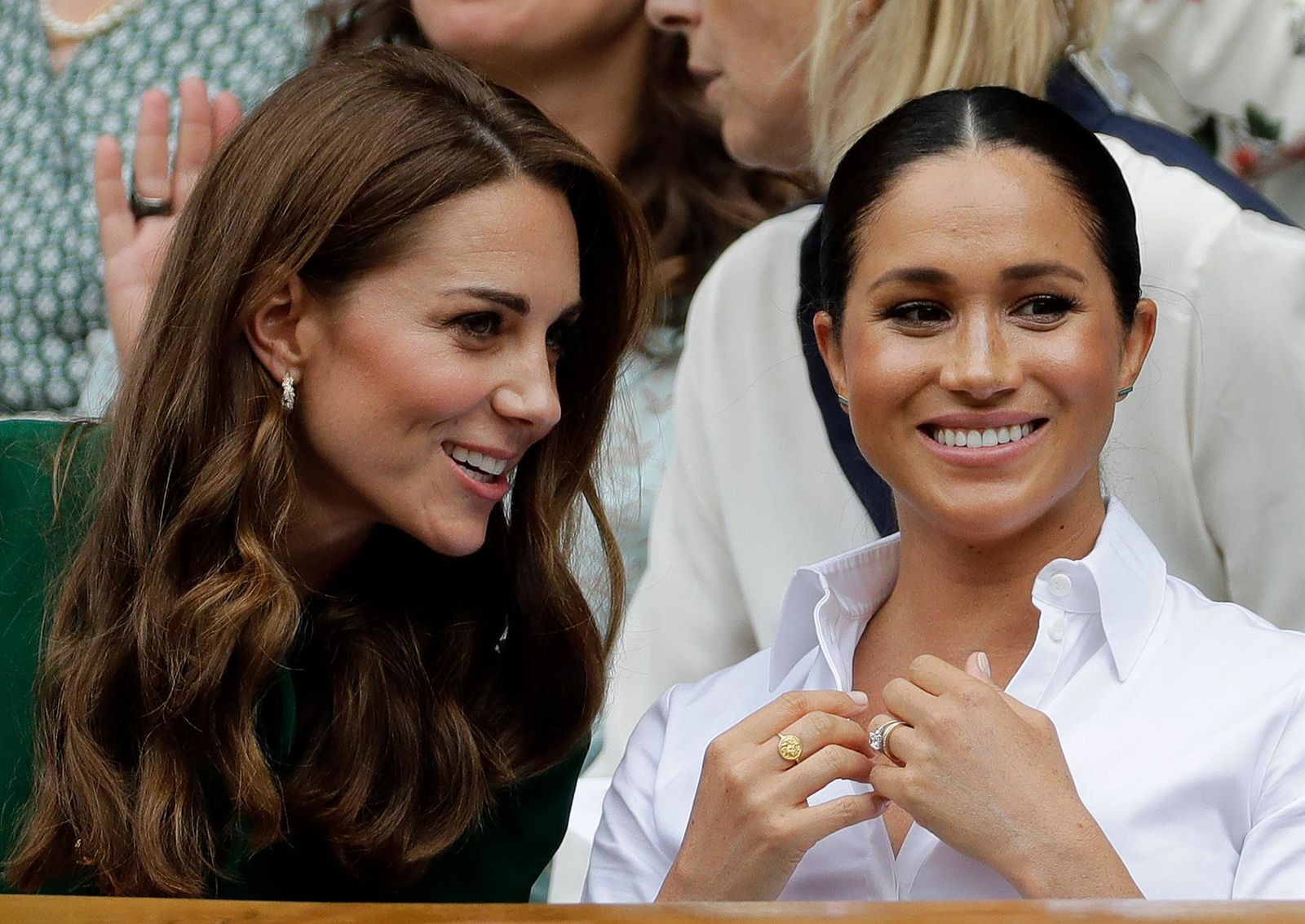 Kate, Duchess of Cambridge, left, and Meghan, Duchess of Sussex chat as they sit in the Royal Box on Centre Court to watch the women's singles final match between Serena Williams of the United States and Romania's Simona Halep on day twelve of the Wimbledon Tennis Championships in London, Saturday, July 13, 2019. (AP Photo/Ben Curtis)