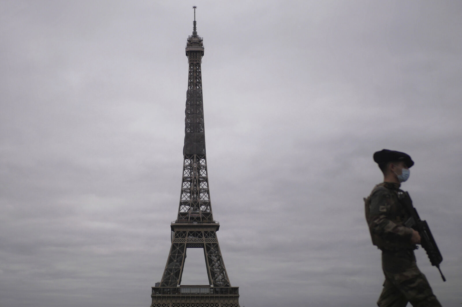 A French soldier patrols next to the Eiffel Tower in Paris, Friday, Oct. 30, 2020.{ } (AP Photo/Thibault Camus)