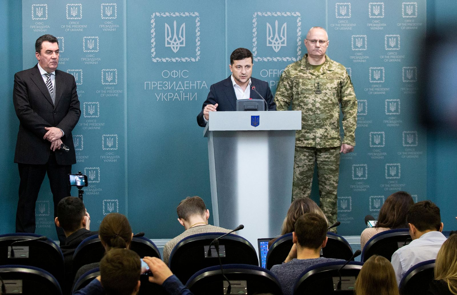 In this handout photo provided by the Ukrainian Presidential Press Office, Ukrainian President Volodymyr Zelenskiy speaks to media at a briefing after the Security Council meeting in Kyiv, Ukraine, Tuesday, Feb. 18, 2020. (Ukrainian Presidential Press Office via AP)