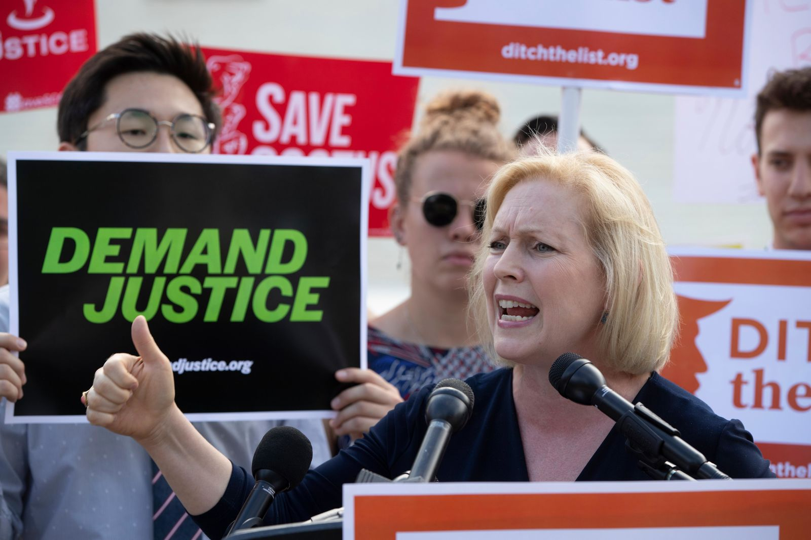 In this June 28, 2018 photo, Sen. Kirsten Gillibrand, D-N.Y., joins activists at the Supreme Court as President Donald Trump prepares to choose a replacement for Justice Anthony Kennedy, in Washington. (AP Photo/J. Scott Applewhite)