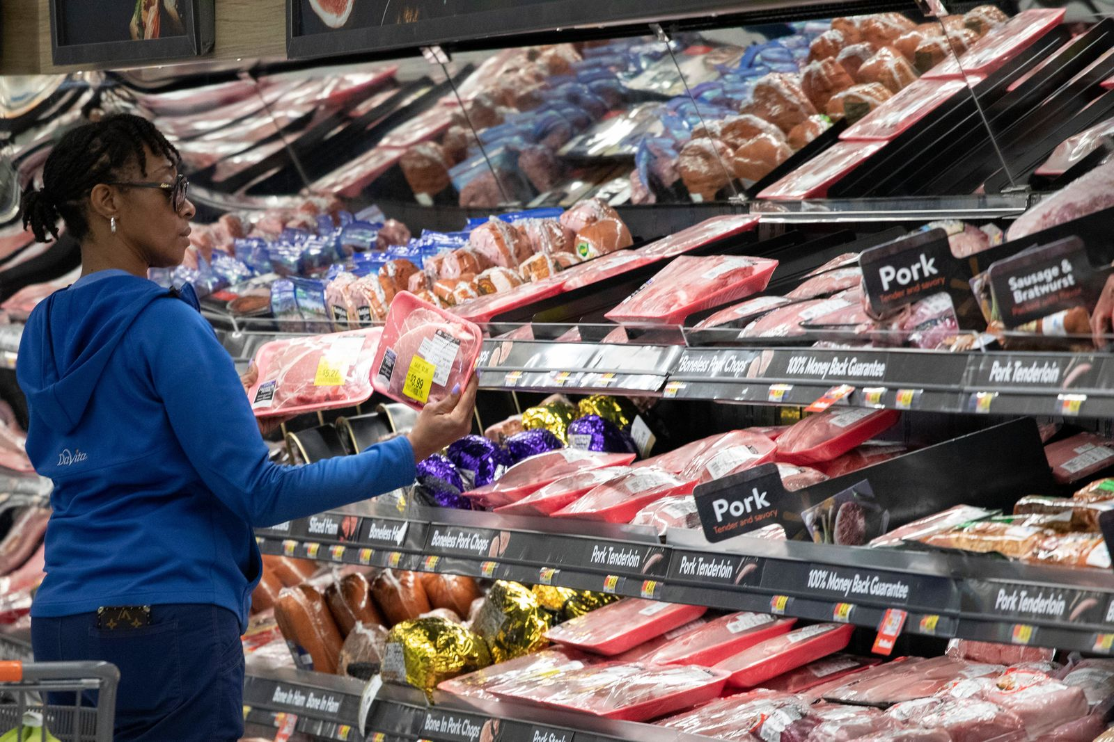 FILE - In this April 24, 2019 file photo,  a customer shops at the meat counter at a Walmart Neighborhood Market in Levittown, N.Y. On Friday, May 10, the Labor Department reports on U.S. consumer prices for March. (AP Photo/Mark Lennihan, File)
