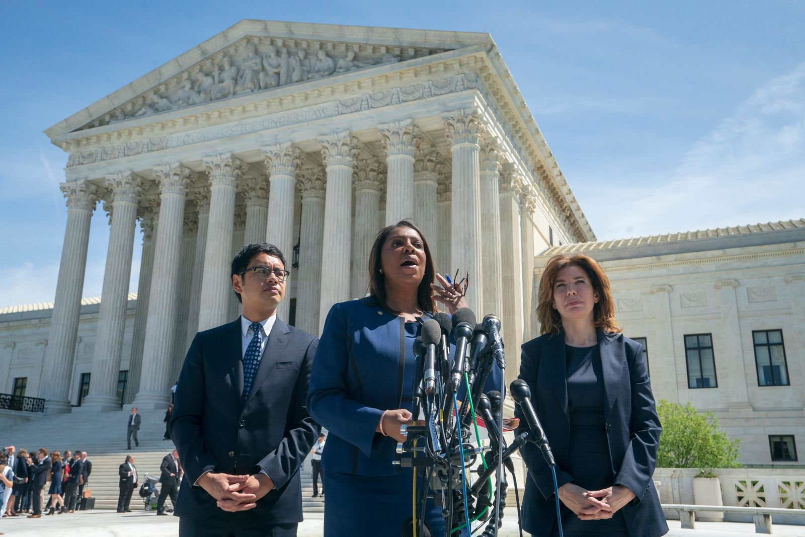 New York State Attorney General Letitia James, center, flanked by Dale Ho, left, an attorney for the American Civil Liberties Union, and New York City Census Director Julie Menin, speaks to reporters after the Supreme Court heard arguments over the Trump administration's plan to ask about citizenship on the 2020 census, in Washington, Tuesday, April 23, 2019. (AP Photo/J. Scott Applewhite)