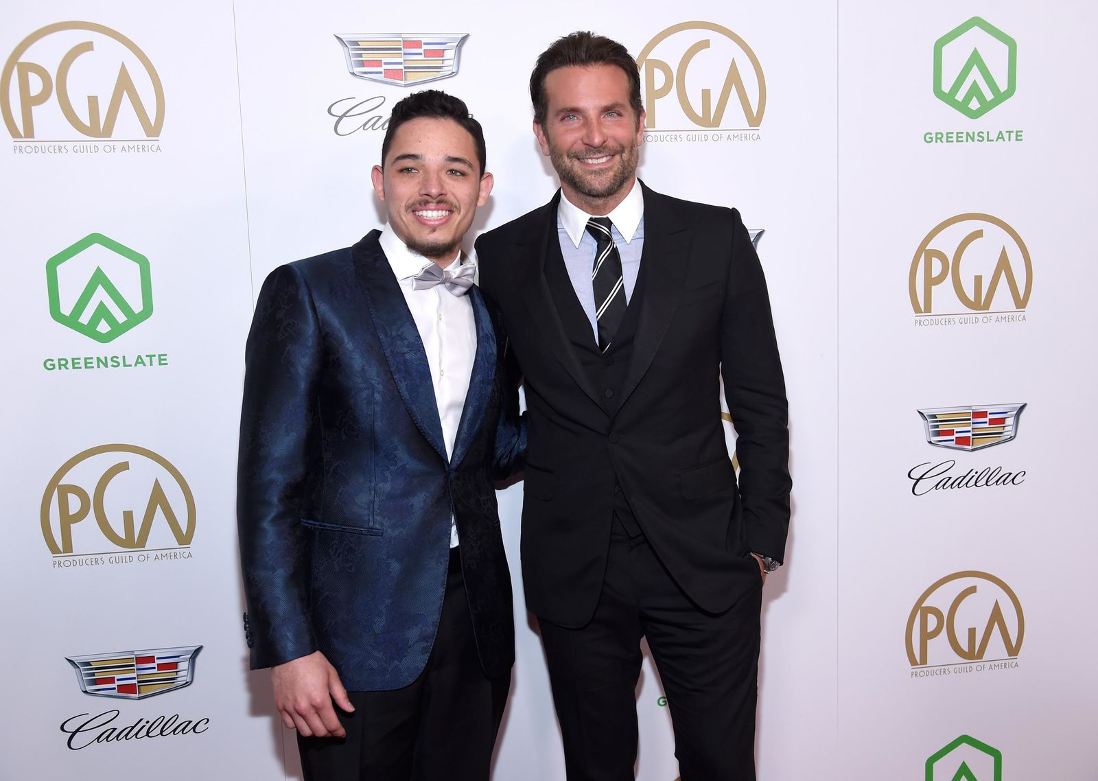 Anthony Ramos, left, and Bradley Cooper arrive at the Producers Guild Awards on Saturday, Jan. 19, 2019, at the Beverly Hilton Hotel in Beverly Hills, Calif. (Photo by Chris Pizzello/Invision/AP)
