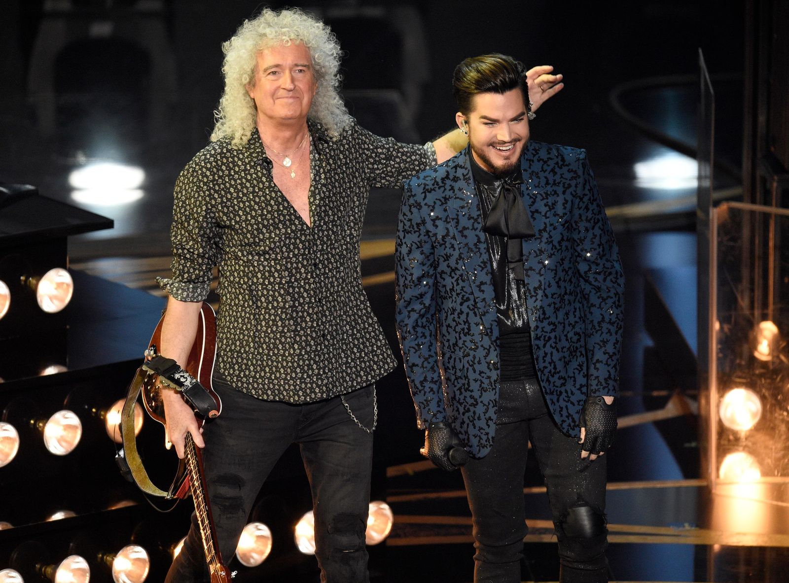 Adam Lambert, right, and Brian May of Queen acknowledge the audience after a performance at the Oscars on Sunday, Feb. 24, 2019, at the Dolby Theatre in Los Angeles. (Photo by Chris Pizzello/Invision/AP)