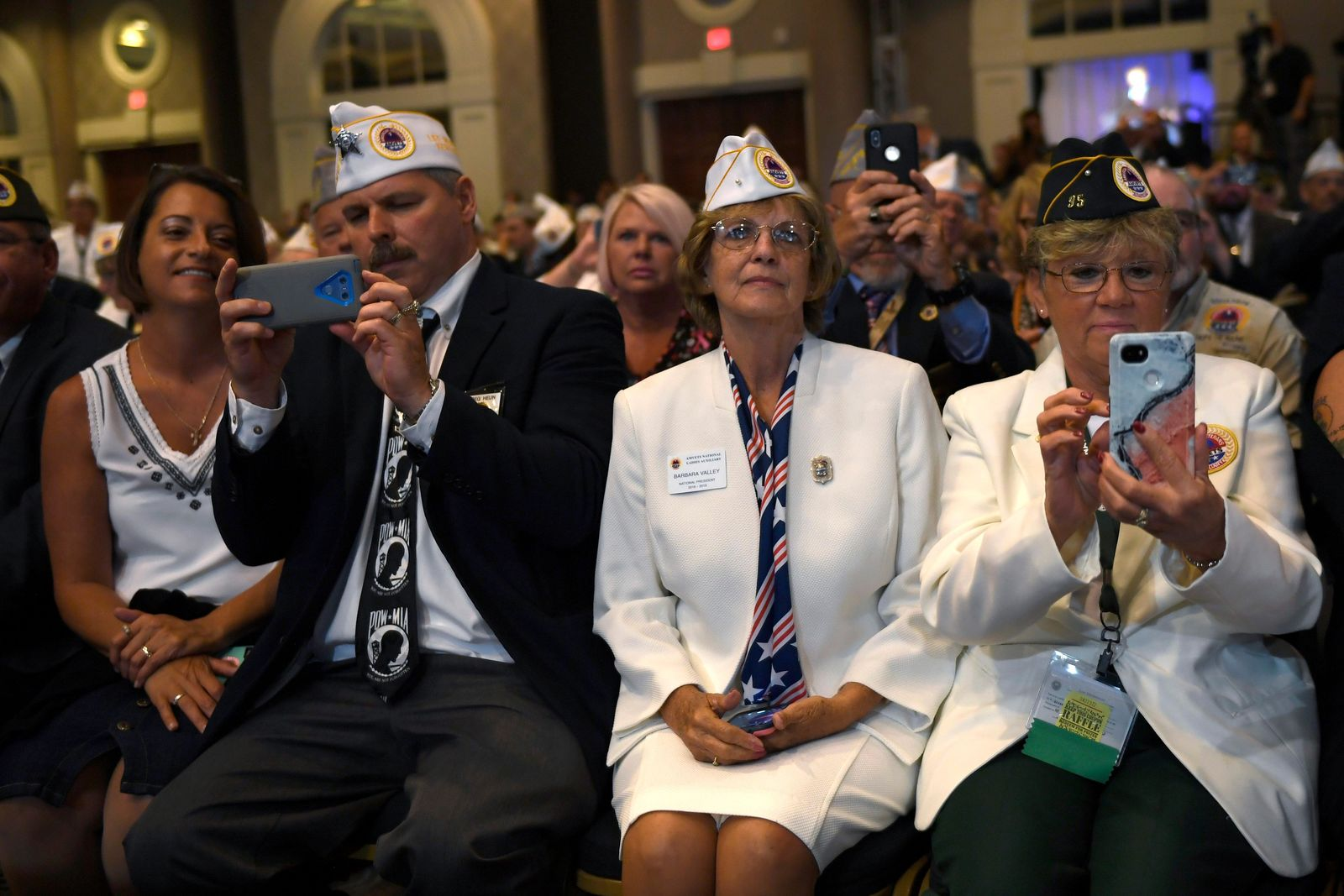 People listen as President Donald Trump speaks at the American Veterans (AMVETS) 75th National Convention in Louisville, Ky., Wednesday, Aug. 21, 2019. (AP Photo/Susan Walsh)