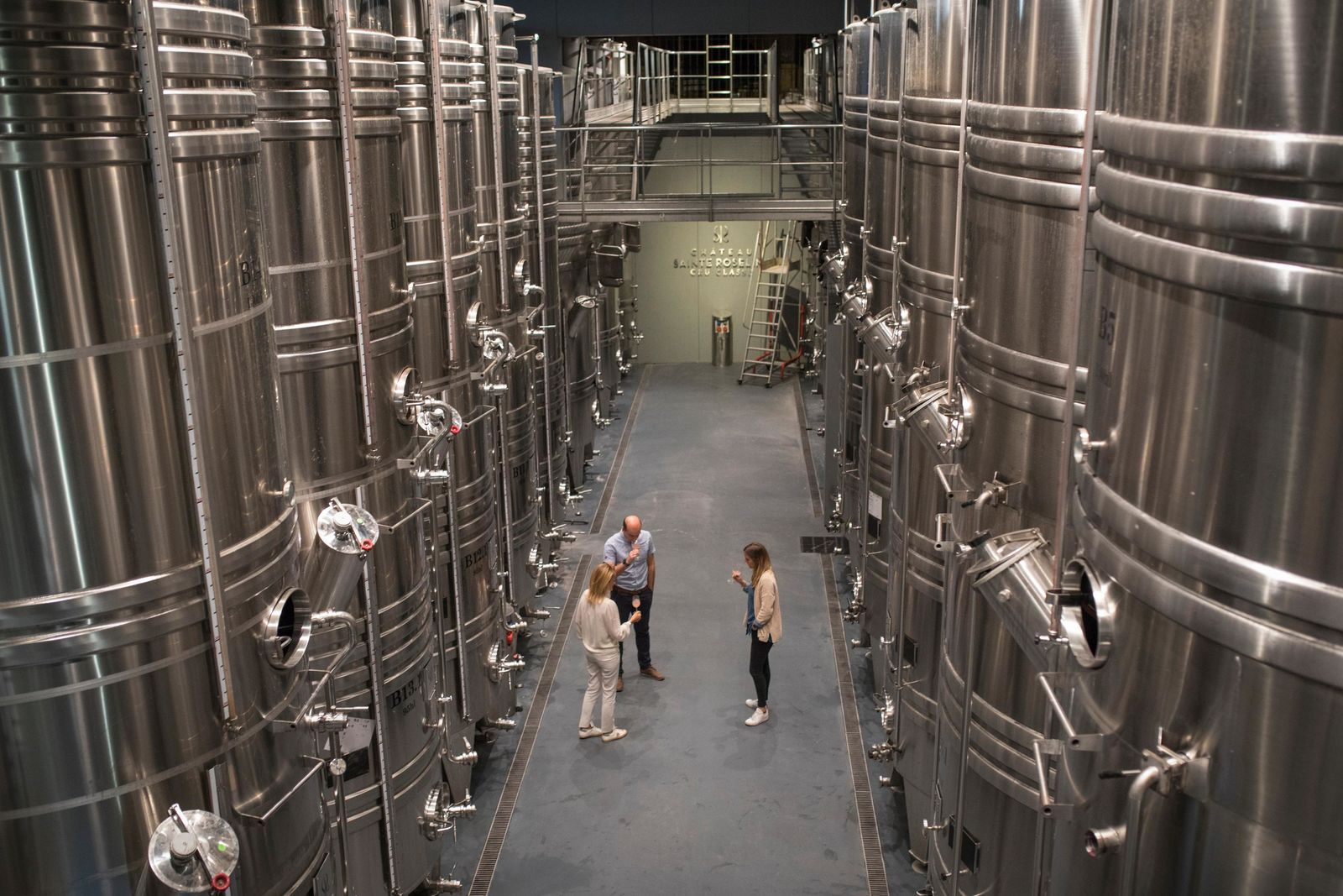 Winemakers taste rose in the production facility of the Chateau Sainte Roseline in the southern France region of Provence Friday Oct. 11, 2019.{ } (AP Photo/Daniel Cole)