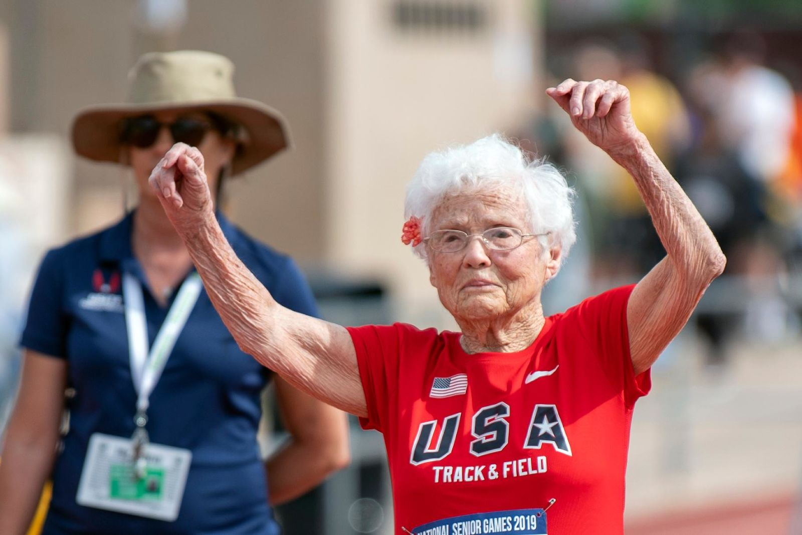 In this photo provided by the National Senior Games Association, 103-year-old Julia Hawkins, of Baton Rouge, La., celebrates after completing the 50-meter dash at the 2019 National Senior Games in Albuquerque, N.M., Monday, June 17, 2019.  (Brit Huckabay/NSGA via AP)