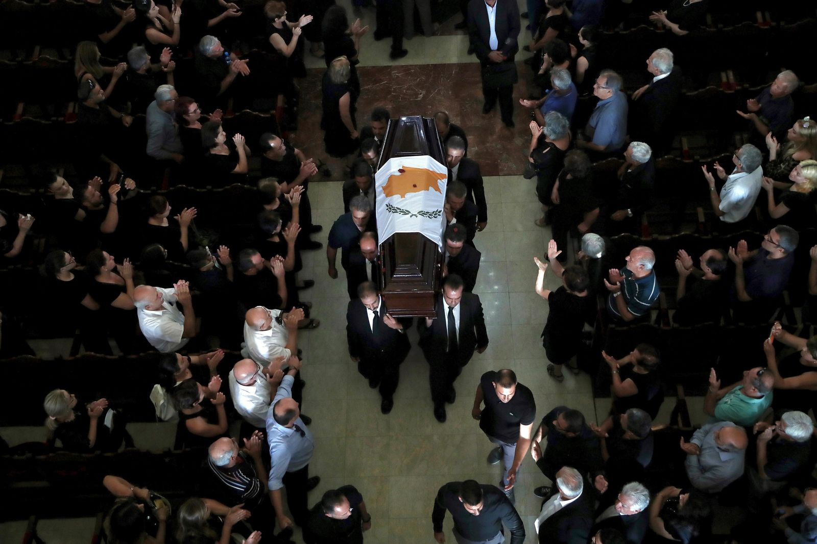 Pallbearers carry the coffin of the former Cyprus' President Dimitris Christofias during his state funeral at the Orthodox Christian Church of the Lord's Wisdom in capital Nicosia, Cyprus, Tuesday, June 25, 2019. European communist and left-wing party heads and leaders from ethnically split Cyprus' breakaway Turkish Cypriot community were among those attending a funeral service for the country's former president Christofias. (AP Photo/Petros Karadjias)