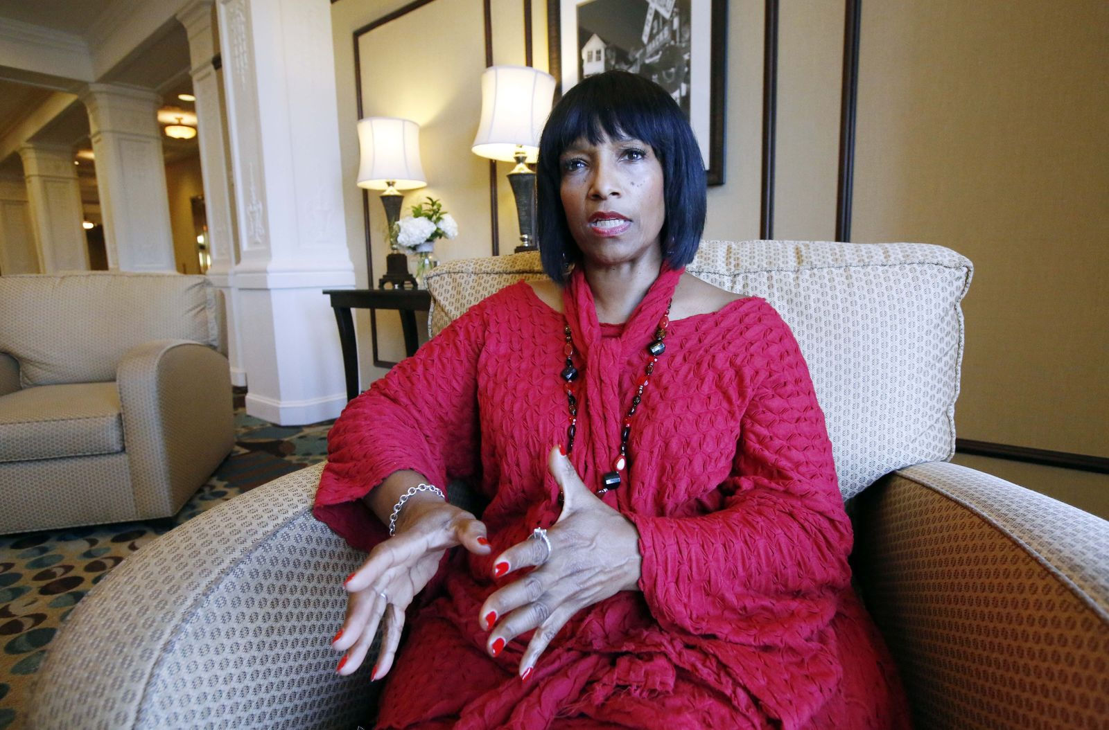 FILE - In this Aug. 27, 2015 file photo, Deborah Watts of Minneapolis, sits in a Jackson, Miss., hotel and speaks about events in Mississippi and Illinois that commemorate the 60th anniversary of the slaying of her cousin, Emmett Till, a black 14-year-old from Chicago, who was visiting relatives in the Mississippi Delta when witnesses said he violated the Jim Crow social code by whistling at a white woman. The government is still investigating the brutal slaying of the black teenager that helped spur the civil rights movement more than 60 years ago. A Justice Department report issued to Congress about civil rights cold case investigations lists the 1955 slaying of Till as being among the unit's active cases.  (AP Photo/Rogelio V. Solis, File)