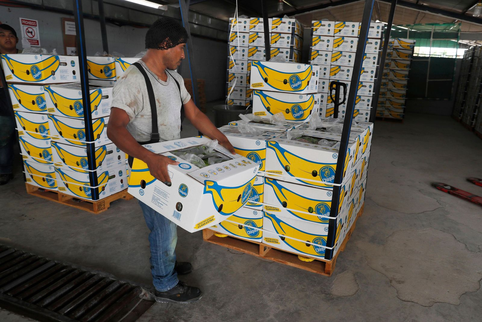FILE - In this May 31, 2019 file photo, =a worker stacks a box of freshly harvested Chiquita bananas to be exported, at a farm in Ciudad Hidalgo, Chiapas state, Mexico. President Donald Trump plans to impose 5% tariffs on Mexican imports starting June 10 and to ratchet them up to 25% by Oct. 1 if the Mexicans don't do more to stop the surge of Central American migrants across the southern U.S. border.  (AP Photo/Marco Ugarte, File)