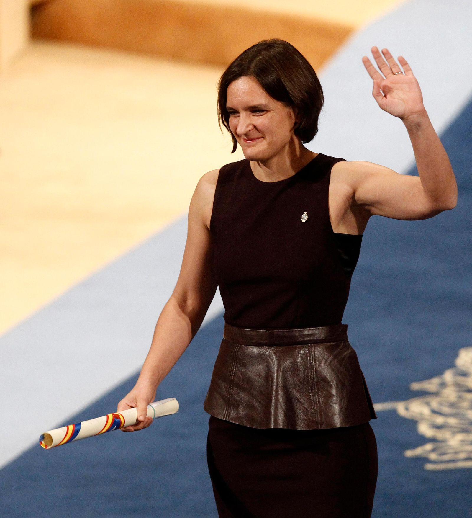 FILE - In this Friday Oct. 23, 2015 file photo, Esther Duflo of France waves after receiving the Princess of Asturias award for Social Sciences from Spain's King Felipe VI at a ceremony in Oviedo, northern Spain.{ } (AP Photo/Jose Vicente, File)