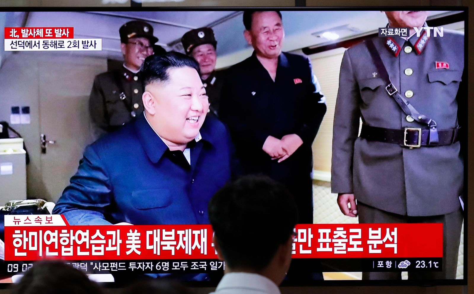 "People watch a TV news program reporting North Korea's firing of projectiles with a file image of North Korean leader Kim Jong Un at the Seoul Railway Station in Seoul, South Korea, Saturday, Aug. 24, 2019. North Korea fired two suspected short-range ballistic missiles off its east coast on Saturday in the seventh consecutive week of weapons tests, South Korea's military said, a day after it threatened to remain America's biggest threat in protest of U.S.-led sanctions on the country. The Korean letters read: ""North Korea fired projectiles."" (AP Photo/Lee Jin-man)"