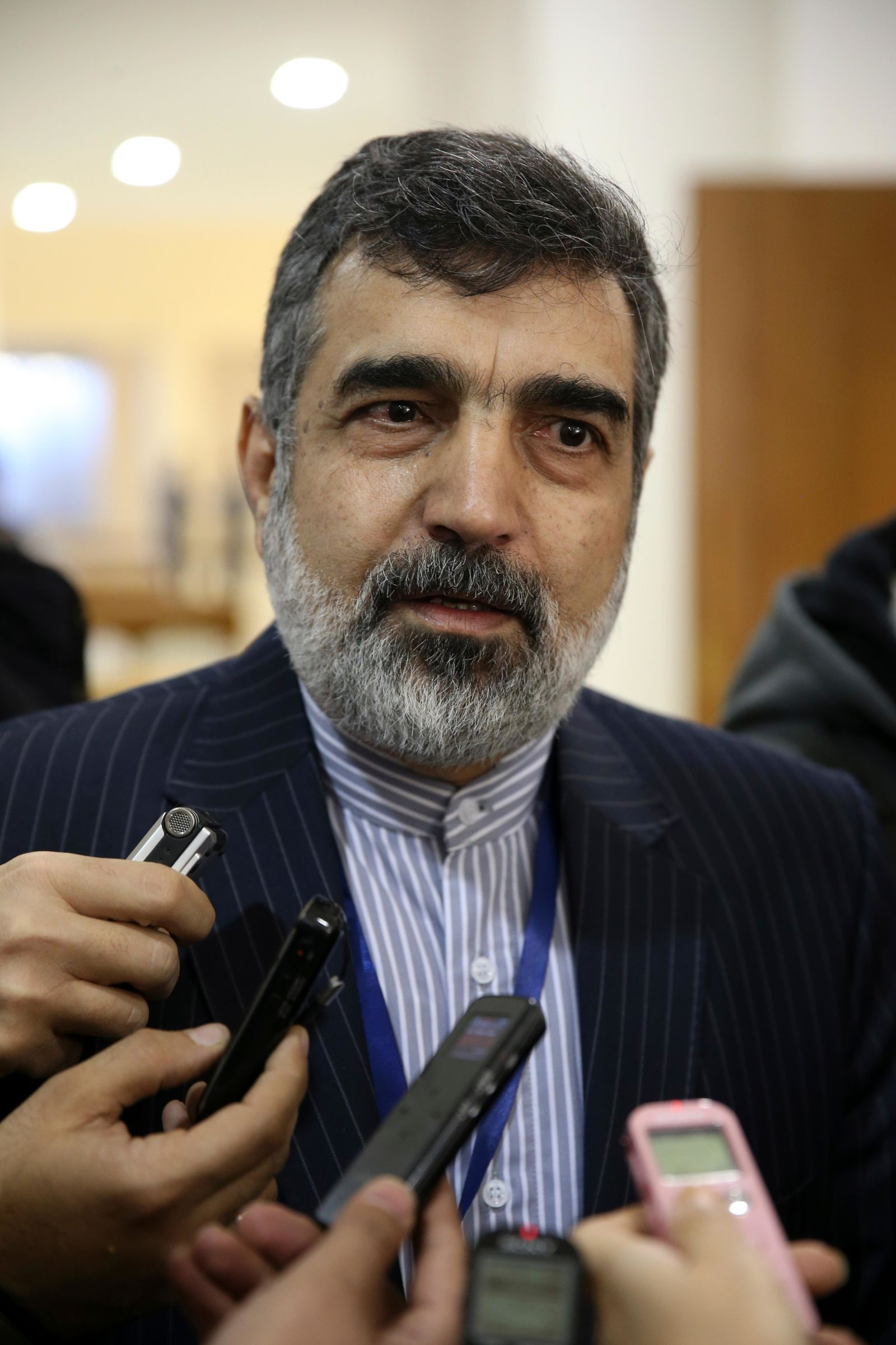 In this photo taken Dec. 9, 2014, spokesman for Iran's atomic agency Behrouz Kamalvandi speaks to the media, in Tehran, Iran. Iran will break the uranium stockpile limit set by Tehran's nuclear deal with world powers in the next 10 days, spokesman for the country's atomic agency Kamalvandi said Monday June 17, 2019, while also warning that Iran has the need for uranium enriched up to 20%, just a step away from weapons-grade levels. (AP Photo/Vahid Salemi)