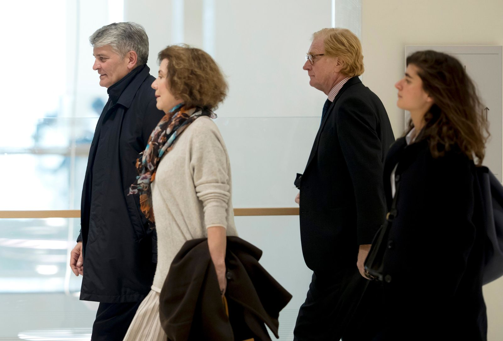 Former CEO of Global Wealth Management and Business Banking at UBS AG Raoul Weil, left, his wife, 2nd left, former General Director of UBS France Patrick de Fayet, 2nd right, and one member of their legal team arrive for the the Swiss bank's trial at the Paris courthouse in Paris, France, Wednesday, Feb. 20, 2019. (AP Photo/Michel Euler)