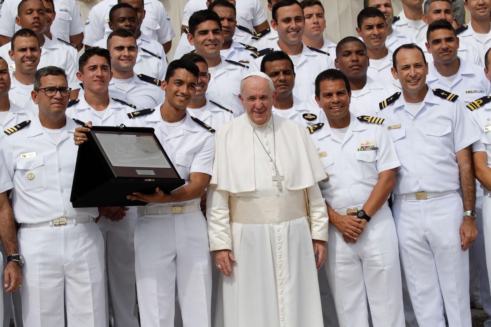 FILE – Pope Francis poses for a family picture with Brazilian Navy personnel during his weekly general audience, in St. Peter's Square at the Vatican, Wednesday, Aug. 28, 2019. (AP Photo/Alessandra Tarantino)