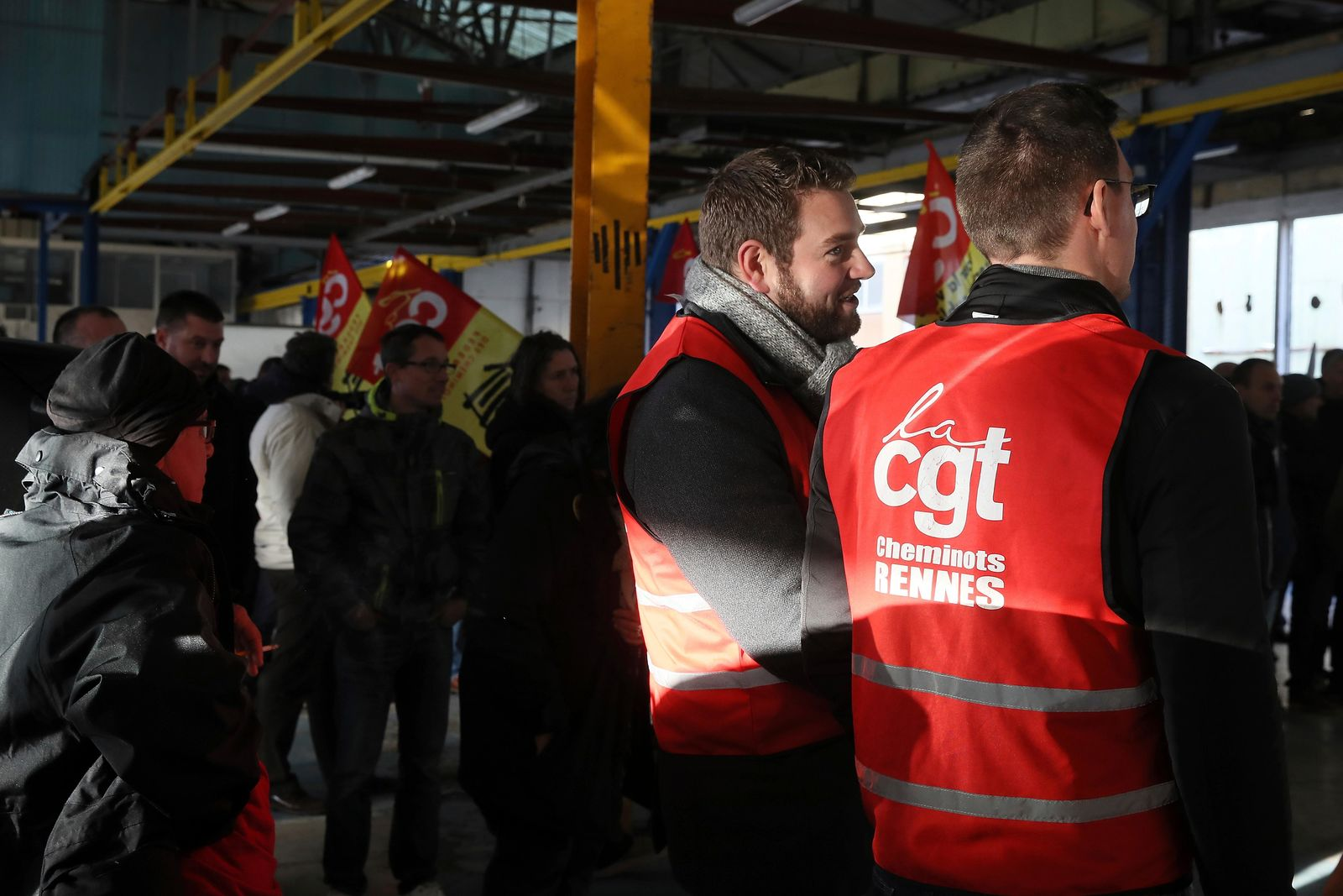 Railway workers gather during a meeting of the CGT union in Rennes, western France, Monday, Dec. 9, 2019.{ } (AP Photo/David Vincent)