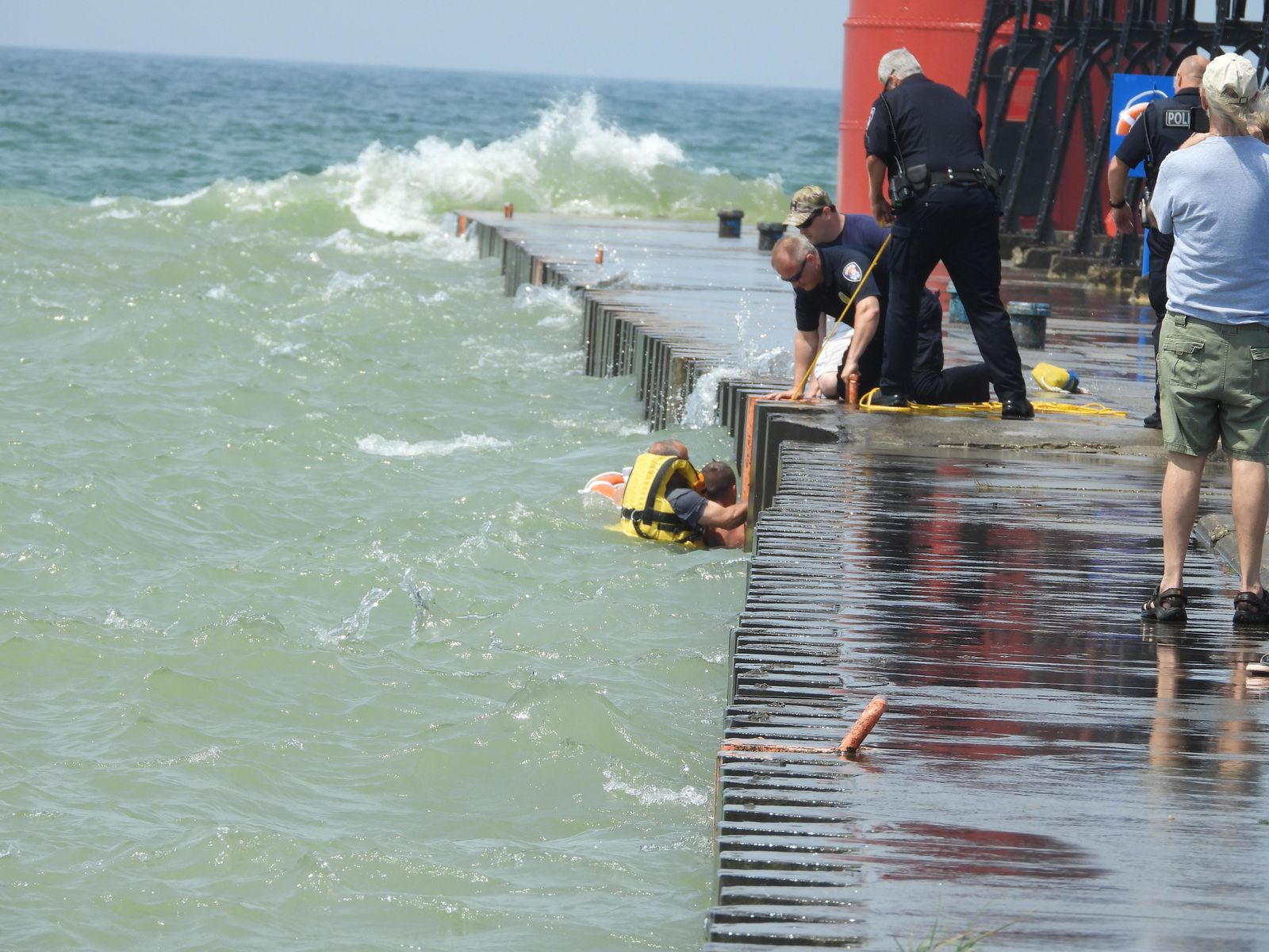 An 18-year-old boy was rescued by officials with the South Haven Area Emergency Services on Friday, after being caught in a rip tide along the South Pier. (WWMT/Courtesy of South Haven Area Emergency Services)