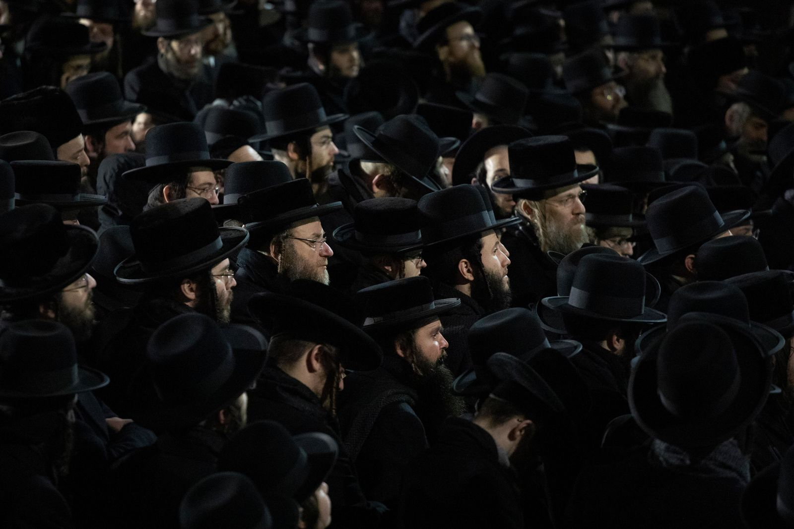 Orthodox Jewish men attend Moshe Deutsch's funeral, Wednesday, Dec. 11, 2019 in the Williamsburg neighborhood of New York. Deutsch was killed Tuesday in a shooting inside a Jersey City, N.J. kosher food market. (AP Photo/Mark Lennihan)