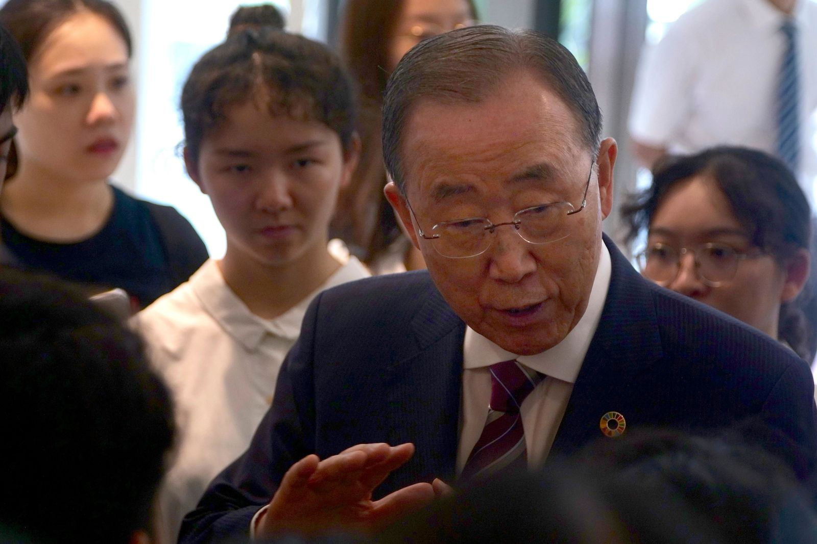 Former U.N. Secretary-General Ban Ki-moon speaks with attendees on the sidelines of a press conference for the release of a report on adapting to climate change in Beijing, Tuesday, Sept. 10, 2019.{ } (AP Photo/Sam McNeil)