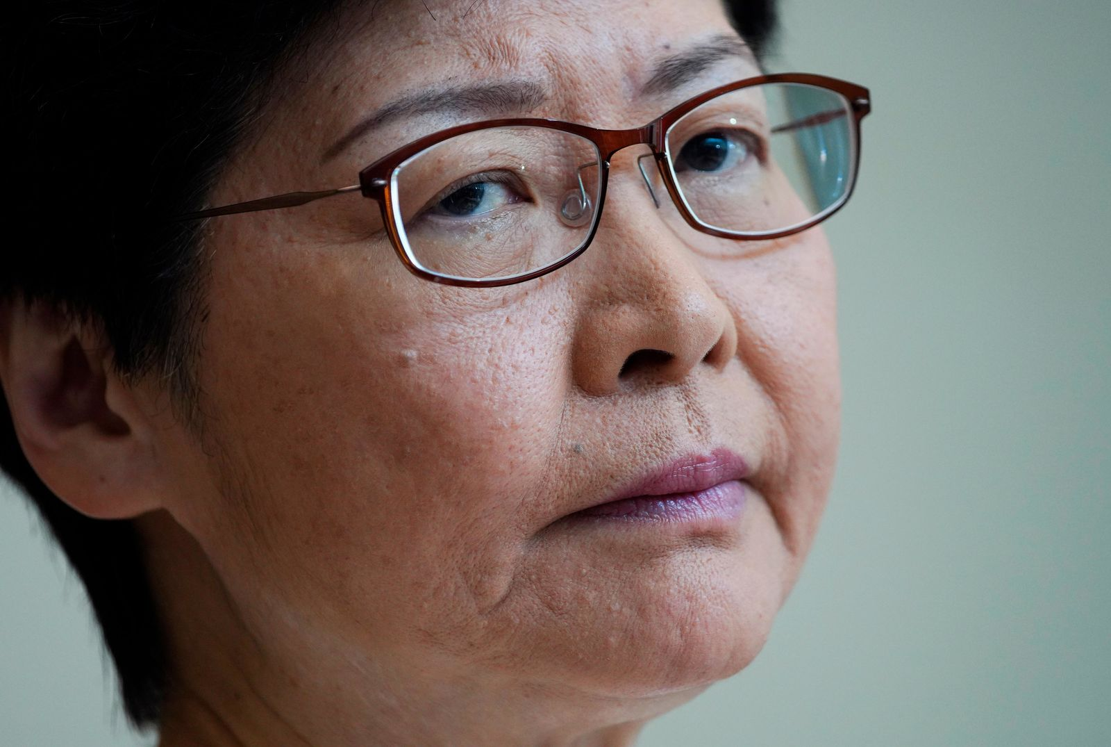 Hong Kong Chief Executive Carrie Lam, listens to reporters questions during a press conference at the government building in Hong Kong Tuesday, Sept. 10, 2019. (AP Photo/Vincent Yu)