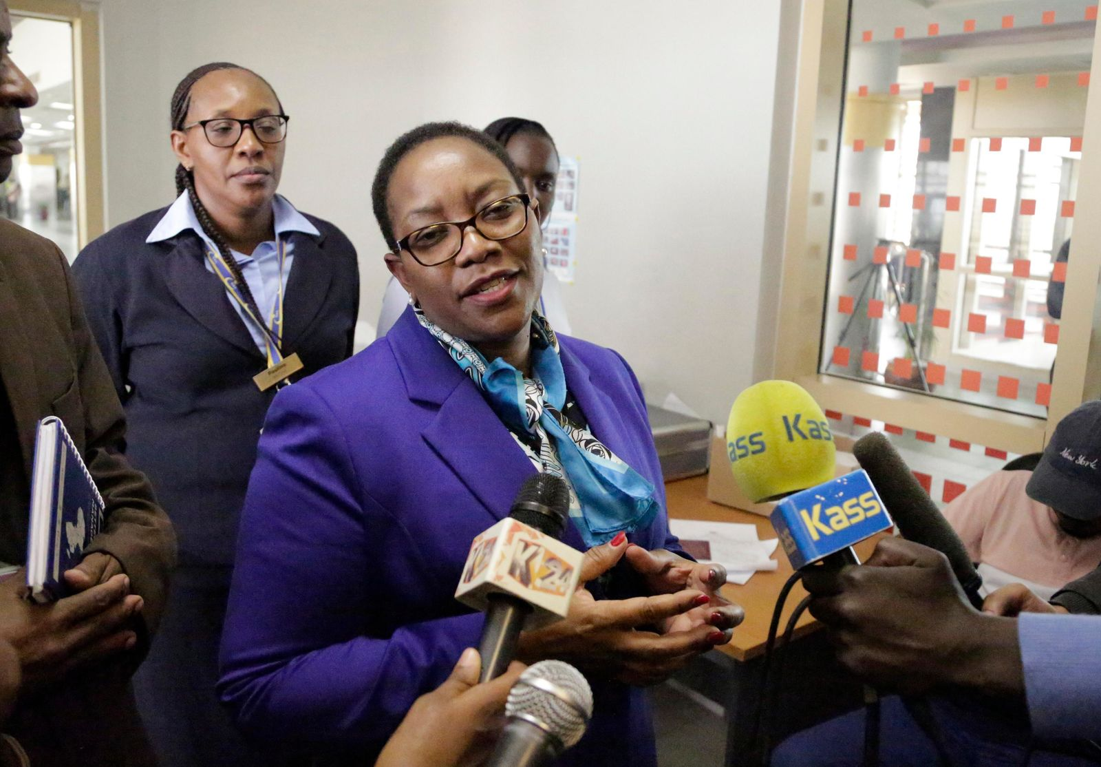 Kenya's health minister Sicily Kariuki speaks to the media about measures the government is taking to prevent Ebola, at the Jomo Kenyatta International Airport in Nairobi, Kenya Monday, June 17, 2019. Kenyan doctors are testing a hospital patient in western Kenya who has Ebola-like symptoms, as eastern Congo is struggling to control the outbreak and Uganda has reported two deaths from the deadly hemorrhagic fever, though Kenya's health minister downplayed the threat Monday. (AP Photo/Khalil Senosi)