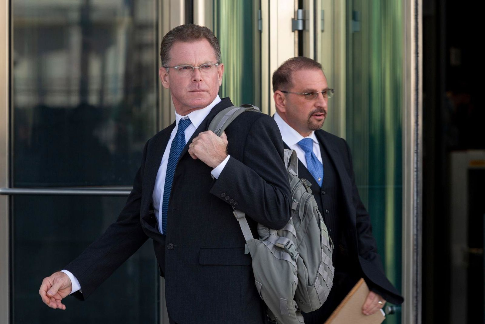 Douglas Haig, left, and his attorney Marc Victor leave the Lloyd George Federal Courthouse, Tuesday Nov. 19, 2019, in Las Vegas, after pleading guilty to illegally manufacturing tracer and armor-piercing bullets found in a high-rise hotel suite where a gunman took aim before the Las Vegas Strip massacre two years ago. Haig is a 57-year-old aerospace engineer who used to reload bullets at home in Mesa, Airz., and sell them at gun shows. He isn't accused of a direct role in the Oct. 1, 2017, shooting that killed 58 people and injured hundreds at an open-air music festival.(Elizabeth Page Brumley/Las Vegas Review-Journal via AP)