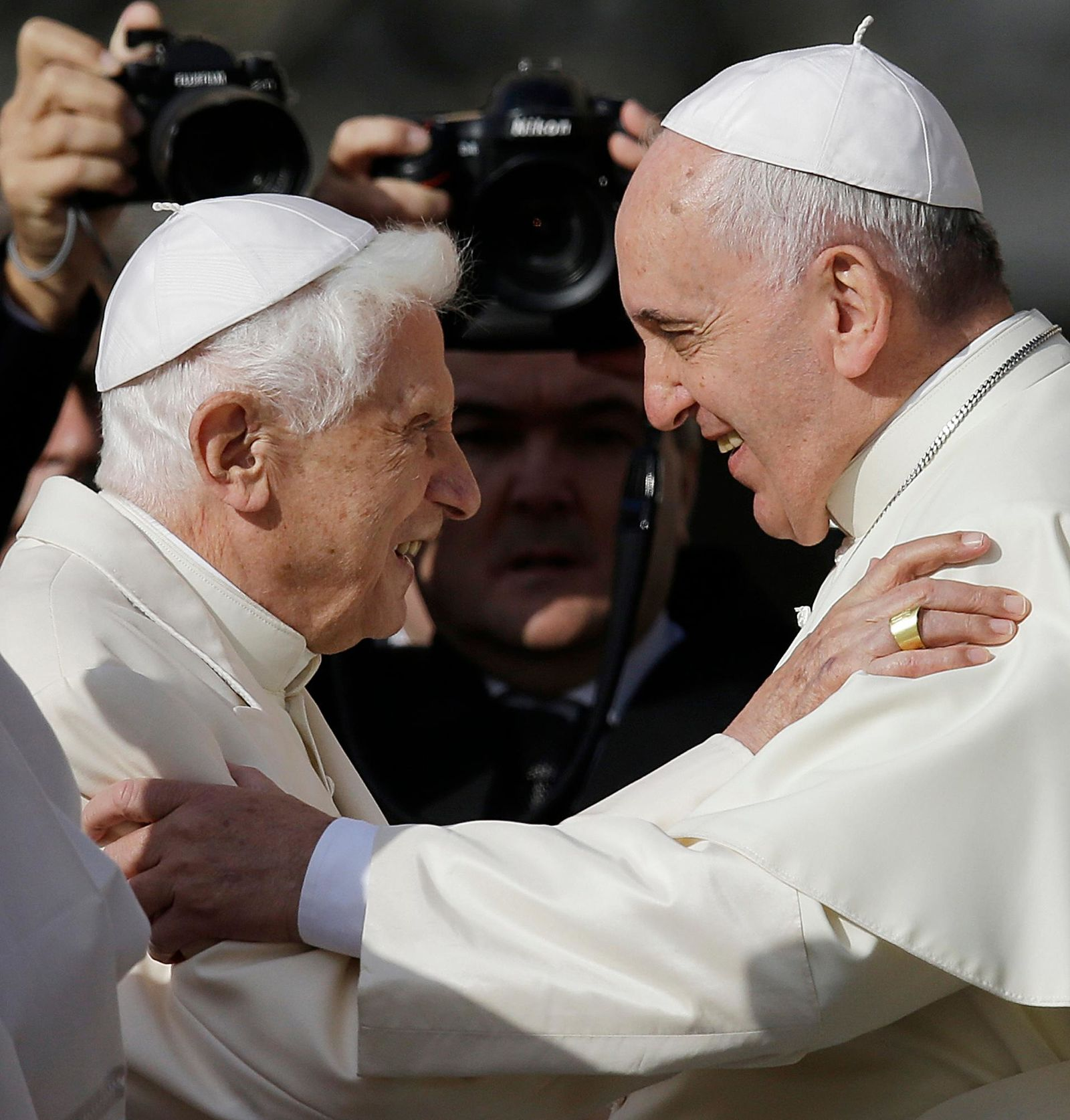 FILE - In this Sept. 28, 2014 file photo, Pope Francis, right, hugs Pope Benedict XVI prior to the start of a meeting with elderly faithful in St. Peter's Square at the Vatican.{ } (AP Photo/Gregorio Borgia, File)