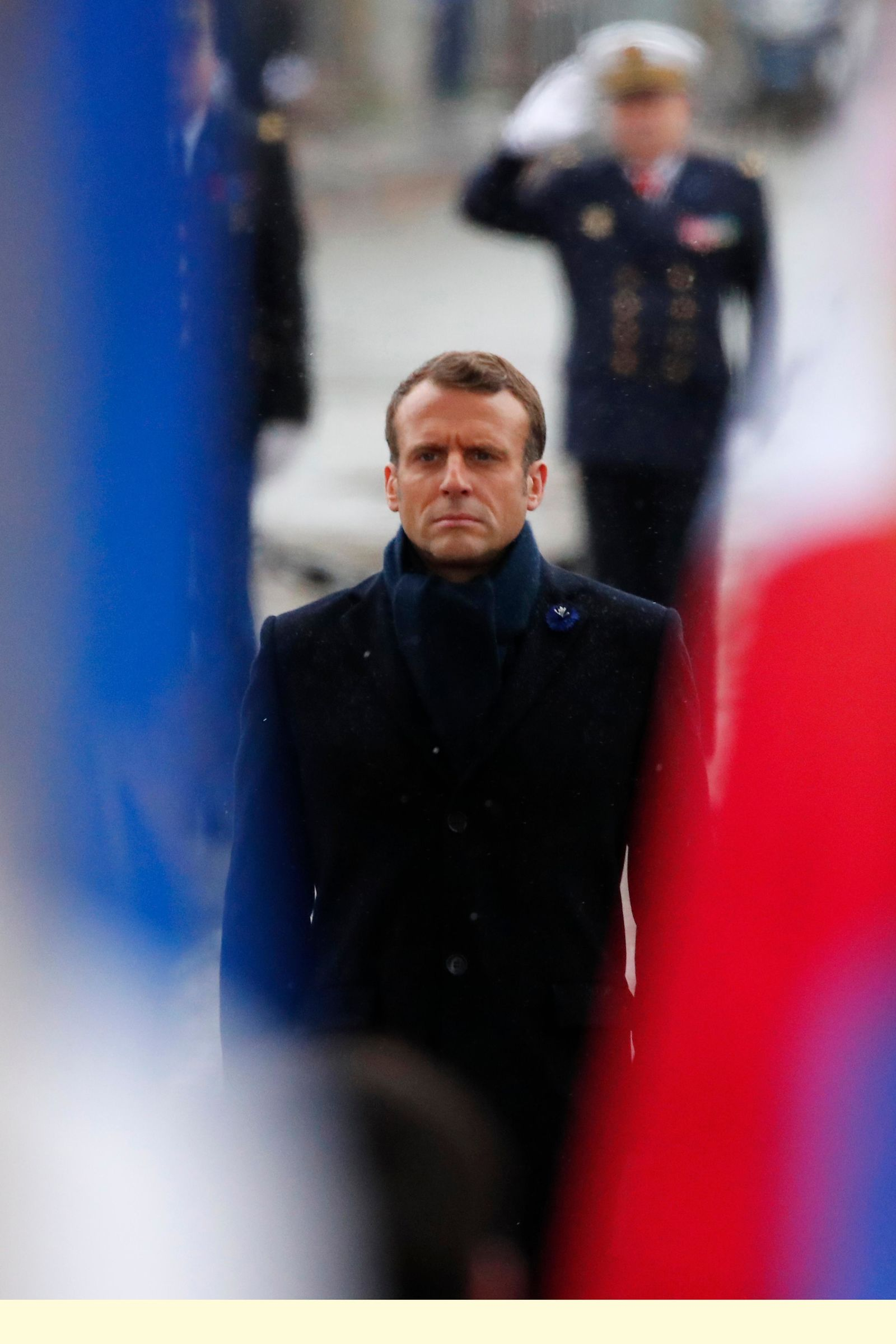 French President Emmanuel Macron stands at attention at the tomb of the Unknown Soldier under the Arc de Triomphe in Paris Monday Nov. 11, 2019 during commemorations marking the 101st anniversary of the 1918 armistice, ending World War I. (AP Photo/Francois Mori, Pool)