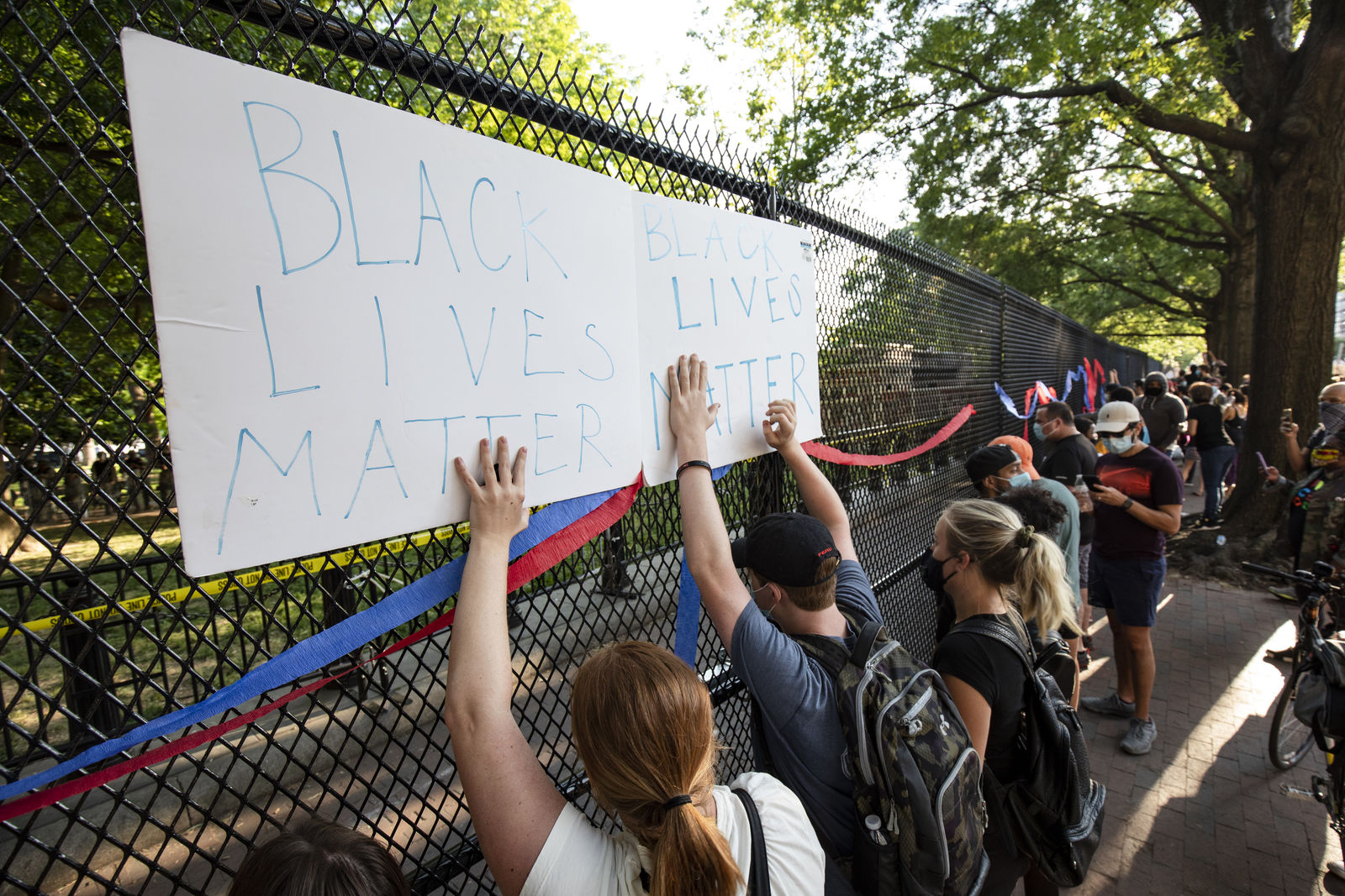 WASHINGTON, DC - JUNE 02: Protestors gather behind a fence across the street from the White House during a demonstration over the death of George Floyd, who died in police custody, on June 2, 2020 in Washington, DC. Protests erupted around the country following the release of a video showing Derek Chauvin, a now former Minneapolis Police officer, kneeling on the neck of Floyd despite Floyd saying I cant breath. (Photo by Samuel Corum/Getty Images)