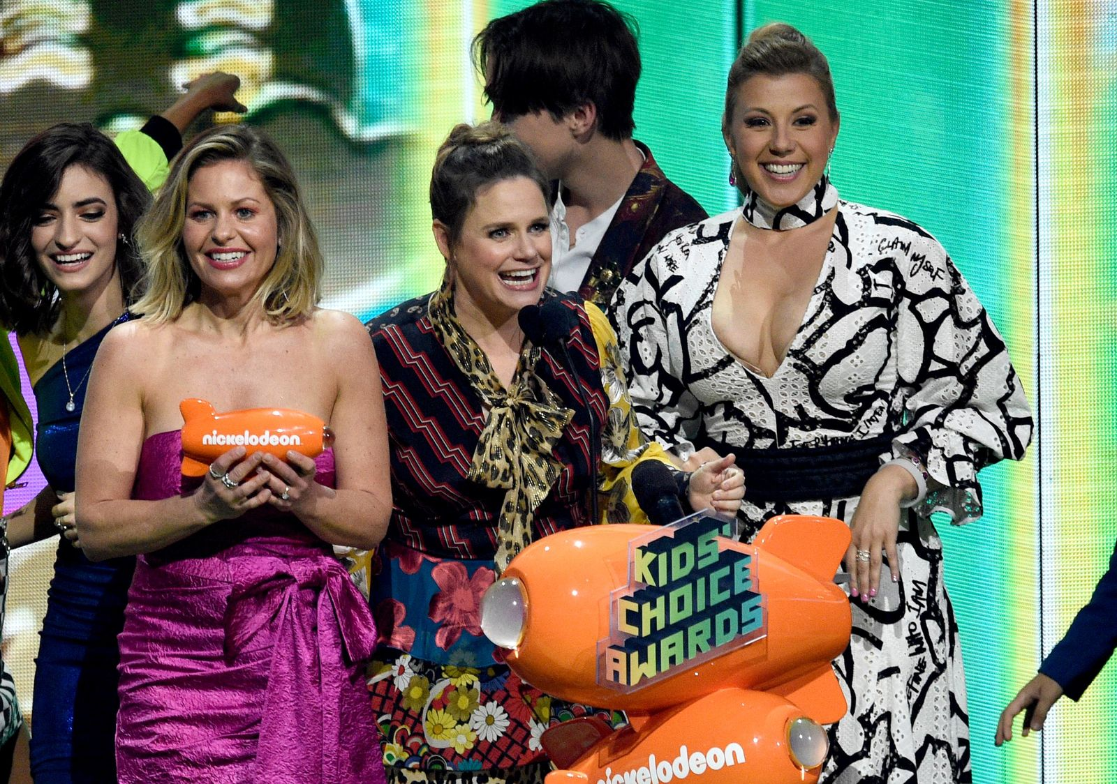 "Candace Cameron-Bure, from left, Andrea Barber and Jodie Sweetin, from the cast of ""Fuller House,"" accept the award for favorite funny TV show at the Nickelodeon Kids' Choice Awards on Saturday, March 23, 2019, at the Galen Center in Los Angeles. (Photo by Chris Pizzello/Invision/AP)"