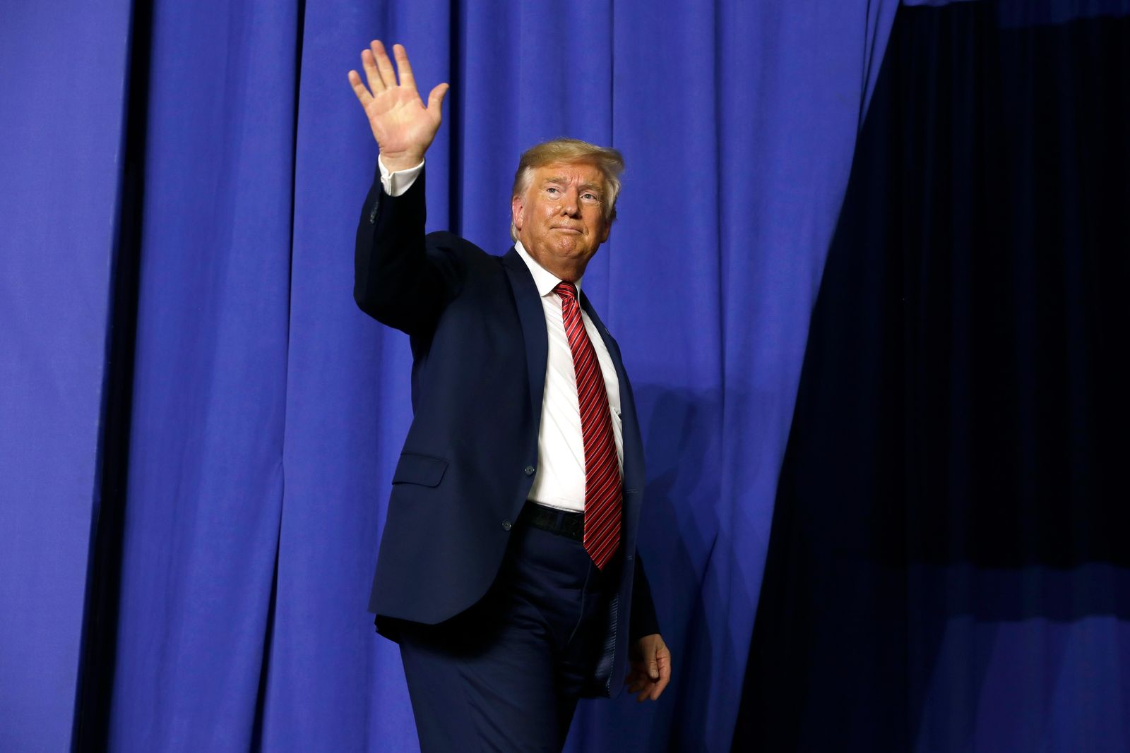 President Donald Trump waves after speaking with Australian Prime Minister Scott Morrison at Pratt Industries, Sunday, Sept 22, 2019, in Wapakoneta, Ohio. (AP Photo/Evan Vucci)