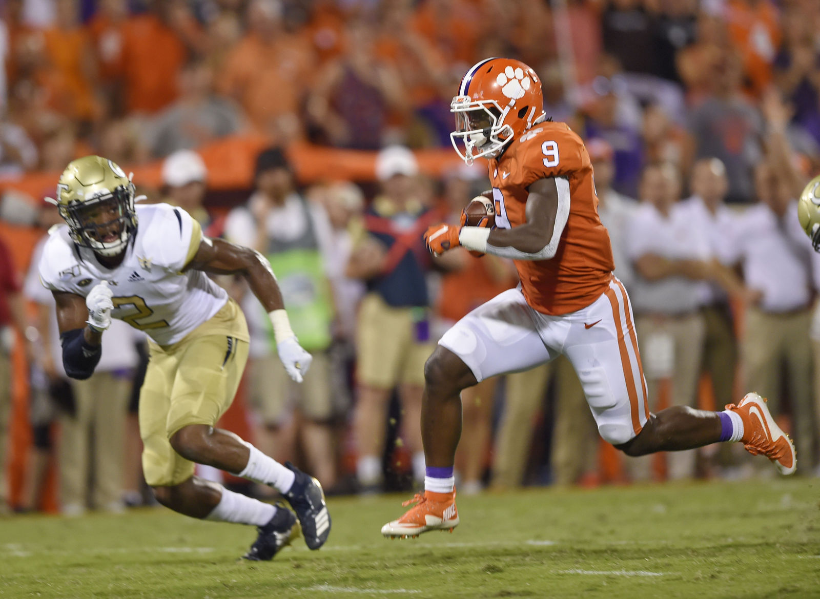 Clemson's Travis Etienne (9) out runs Georgia Tech's Tariq Carpenter to score a touchdown during the first half of an NCAA college football game Thursday, Aug. 29, 2019, in Clemson, S.C. (AP Photo/Richard Shiro)