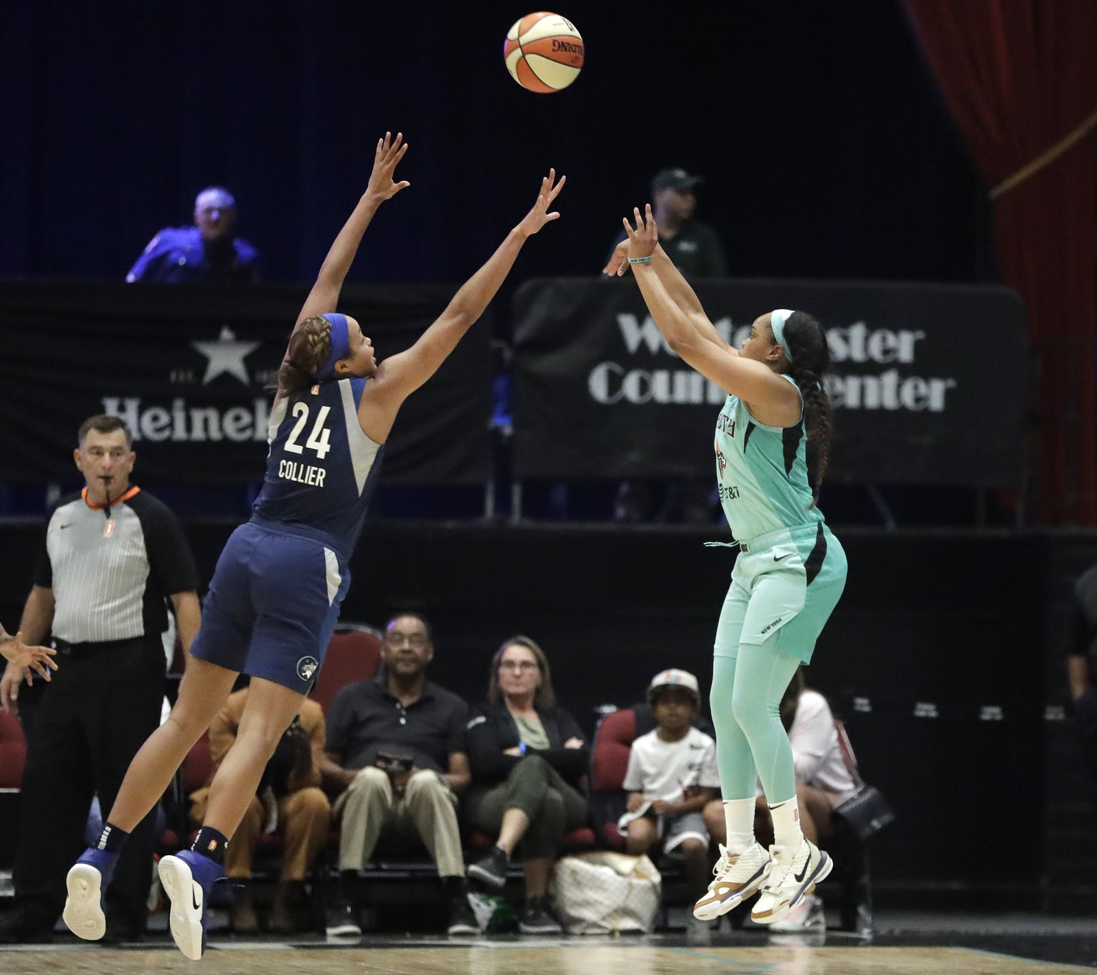 Minnesota Lynx forward Napheesa Collier (24) defends on a 3-point shot by New York Liberty's Brittany Boyd during the second half of a WNBA basketball game Tuesday, Aug. 13, 2019, in White Plains, N.Y. The Lynx won 89-73. (AP Photo/Kathy Willens)