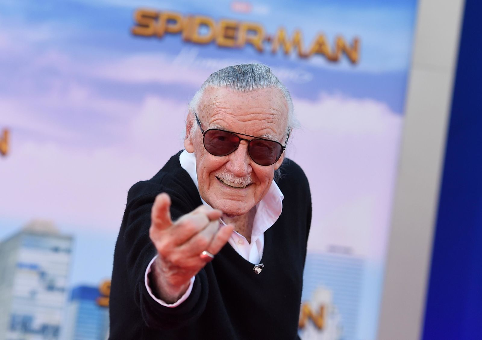 "FILE - In this June 28, 2017 file photo, Stan Lee arrives at the Los Angeles premiere of ""Spider-Man: Homecoming"" at the TCL Chinese Theatre. For comics lovers, Lee was as much a superhero as the characters he helped create. Those fans, along with Lee's friends and colleagues, will get to pay their final respects at a Hollywood memorial Wednesday, Jan. 30, 2019, for the Marvel Comics mastermind who helped bring the world Spider-Man, Black Panther and The Incredible Hulk. (Photo by Jordan Strauss/Invision/AP, File)"