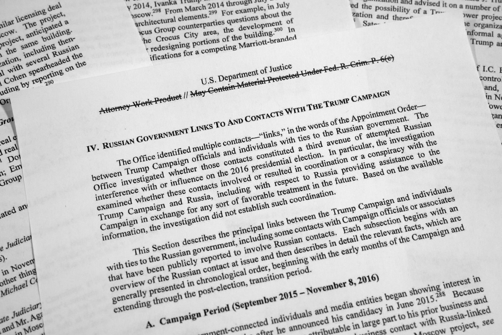 Special counsel Robert Mueller's redacted report on Russian interference in the 2016 presidential election as released on Thursday, April 18, 2019, is photographed in Washington. The section discusses Russian government links and contacts with the Trump campaign. (AP Photo/Jon Elswick)