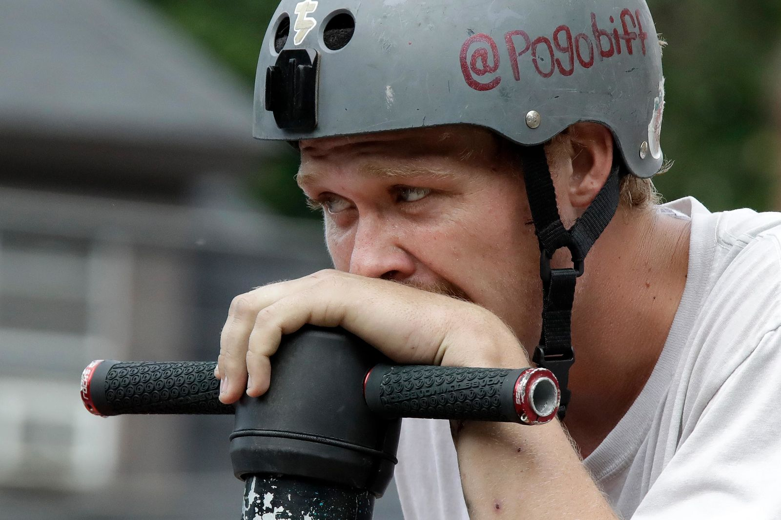 Biff Hutchison, of Burley, Idaho, takes a breather during his performance during Pogopalooza, The World Championships of Pogo in Wilkinsburg, Pa., Saturday, July 20, 2019. (AP Photo/Gene J. Puskar)