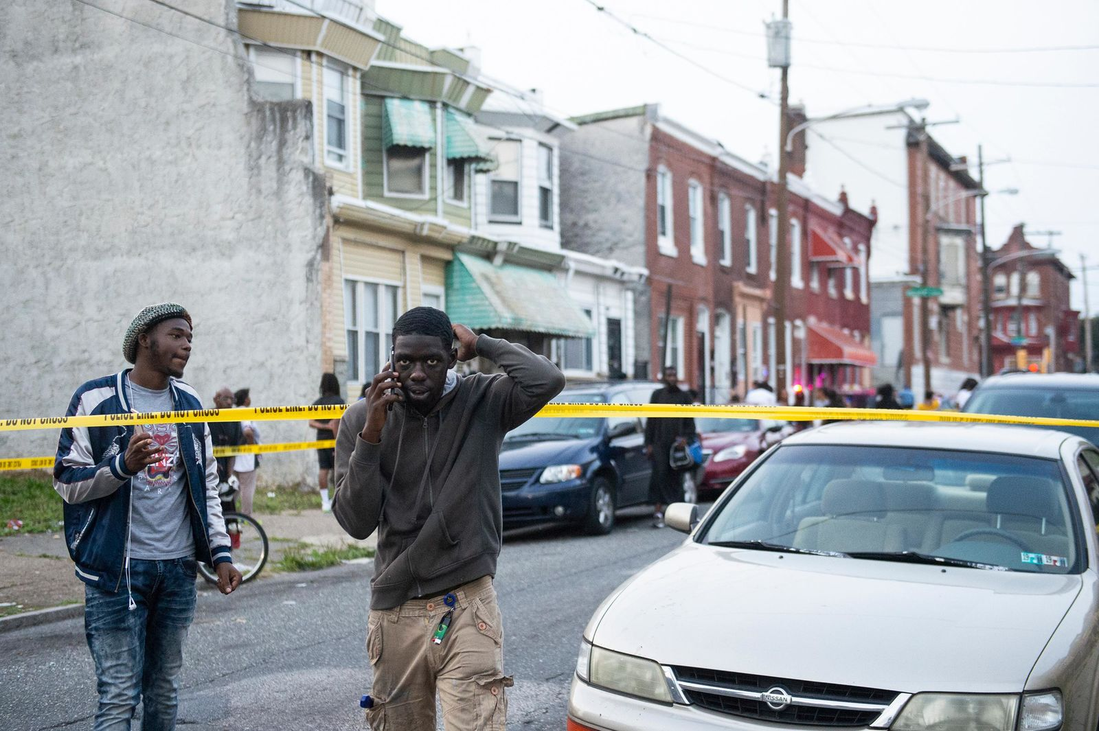 Onlookers gather as a shooting is investigated, Wednesday, Aug. 14, 2019, in Philadelphia. (Joe Lamberti/Camden Courier-Post via AP)