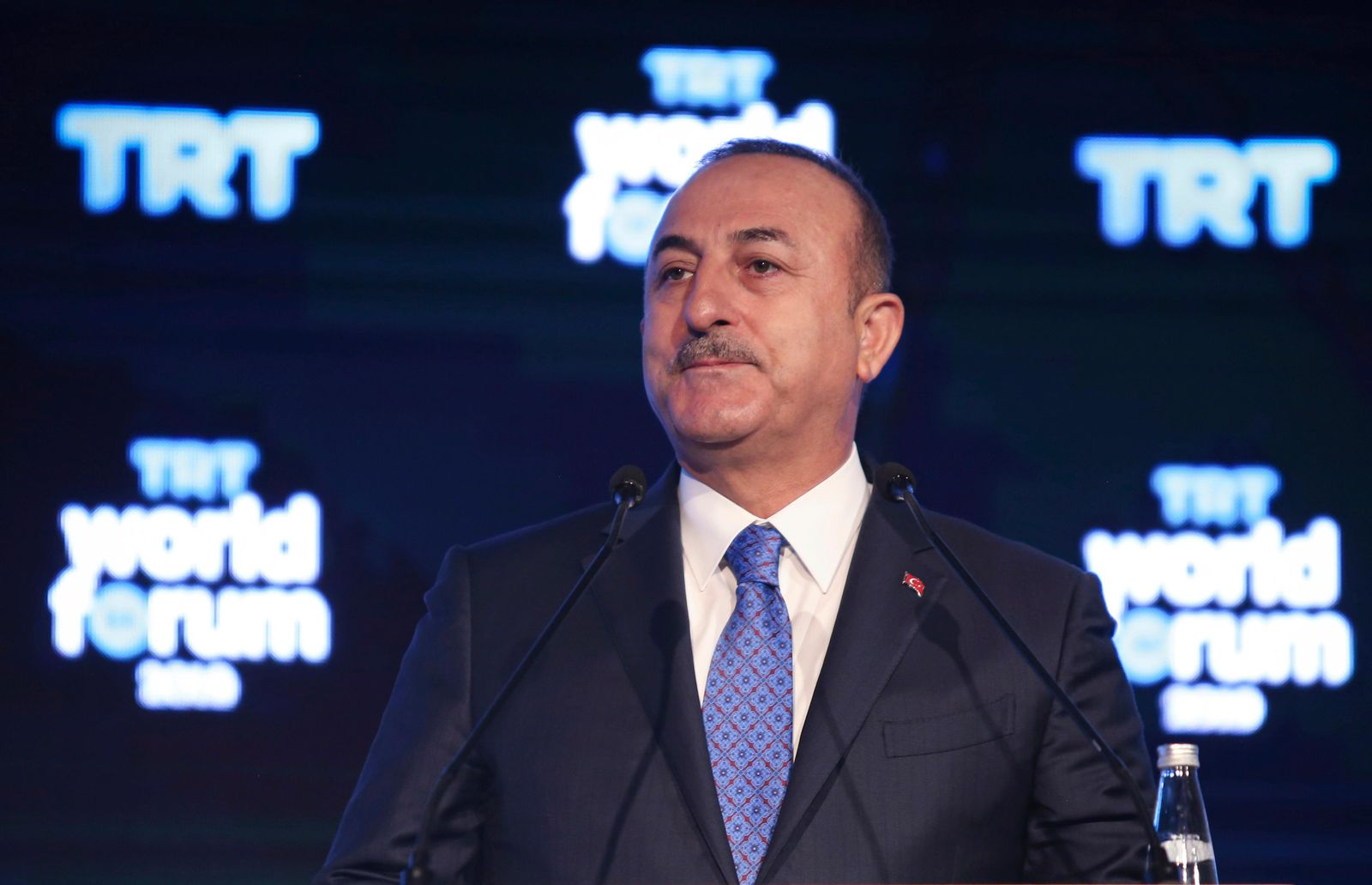 Turkish Foreign Minister Mevlut Cavusoglu speaks at a forum, in Istanbul, Monday, Oct. 21, 2019. Cavusoglu has renewed a warning that the country will resume its military offensive in northeast Syria if Kurdish fighters do not vacate the region at the end of a U.S.-brokered cease-fire that ends Tuesday evening.(Turkish Foreign Ministry via AP, Pool )